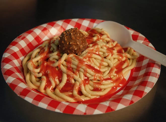 A plate of Cookie Dough Spaghetti, co-created by Dennis Mitchell of Coralville, will be sold at the Dipped In Chocolate ice cream stand at the Pavilion on the Iowa State Fair grounds.
