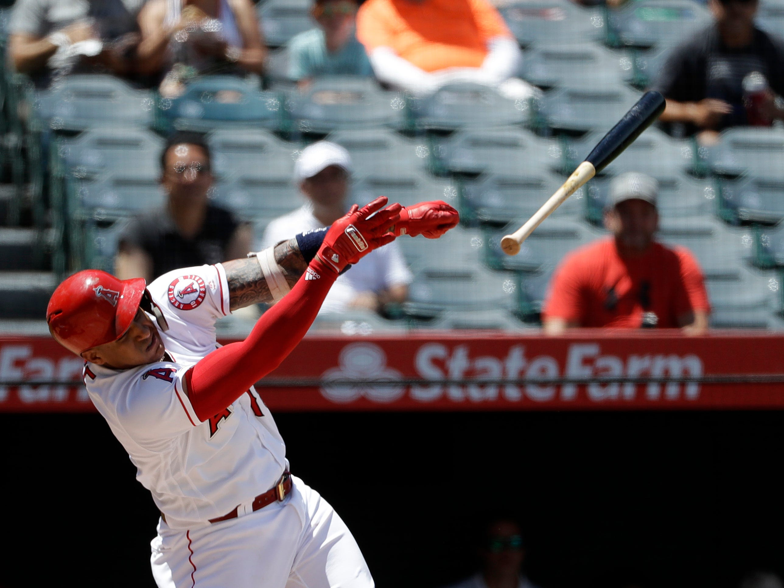 Los Angeles Angels' Jefry Marte loses his bat as he swings during the first inning of a baseball game against the Detroit Tigers, Wednesday, Aug. 8, 2018, in Anaheim, Calif.