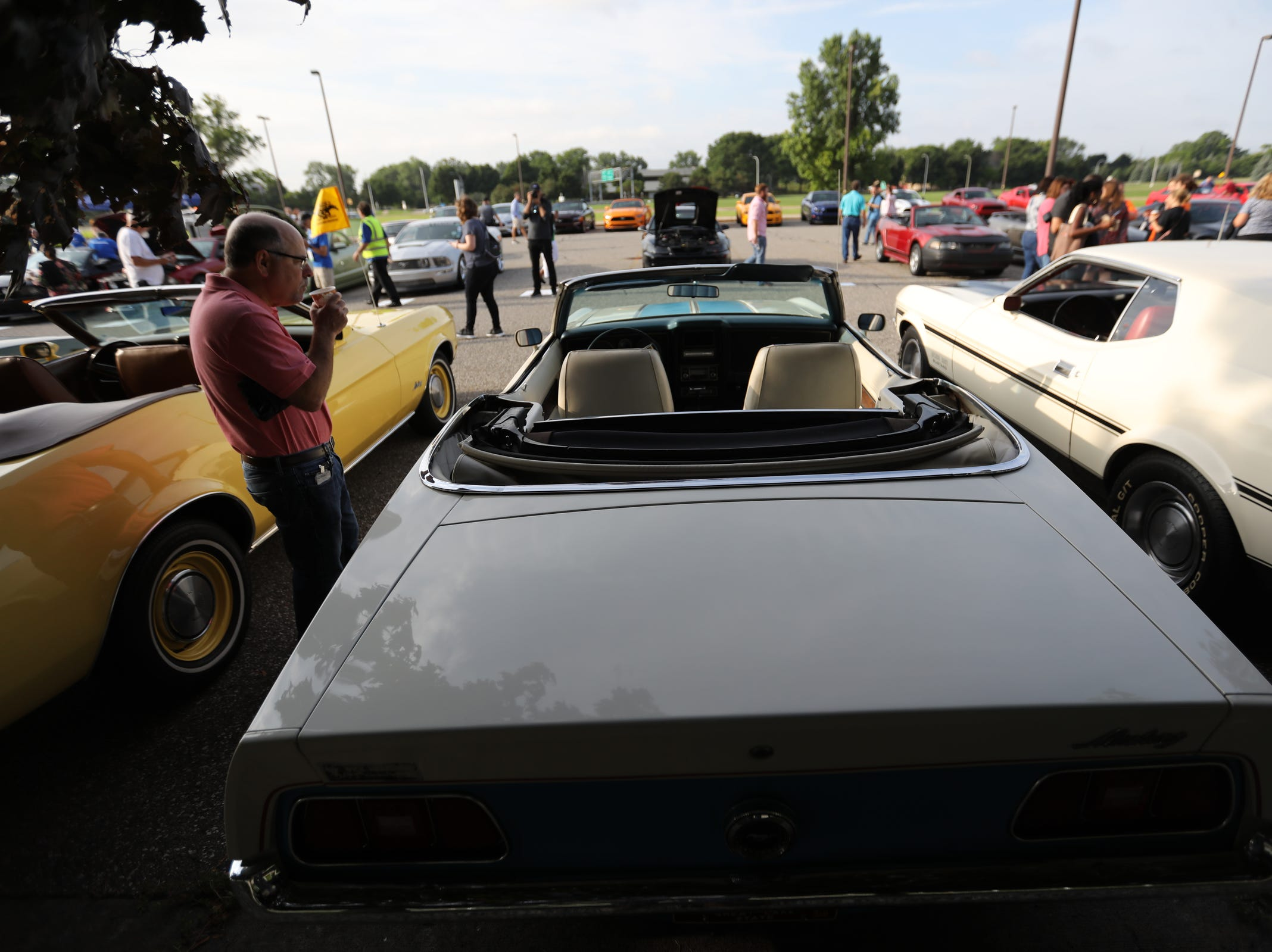 A 1972 Ford Mustang convertible is admired, during a Ford event celebrating the 10,000,000 Mustang built at the Ford Motor Company World Headquarters in Dearborn on Wed., Aug 8, 2018.