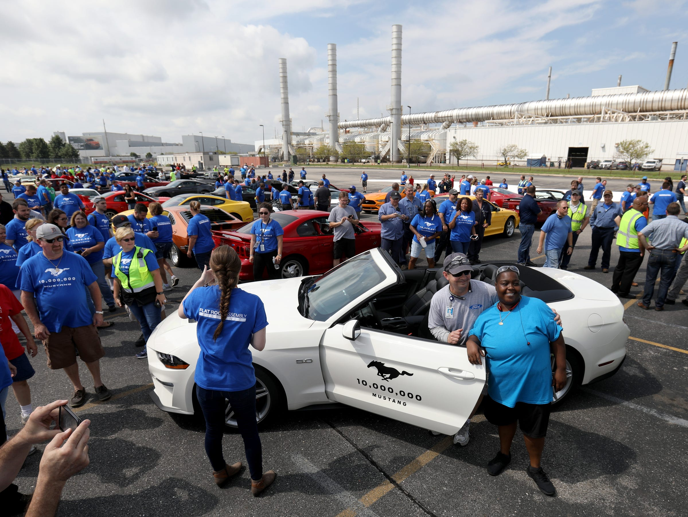 Tommy Lewis of Wyandotte and Danyelle Lampley of Monroe and assembly line workers have their picture taken in front of the 10 millionth Mustang at the Ford Motor Company Flat Rock Assembly Plant in Flat Rock, MI on Wednesday, August 8, 2018.