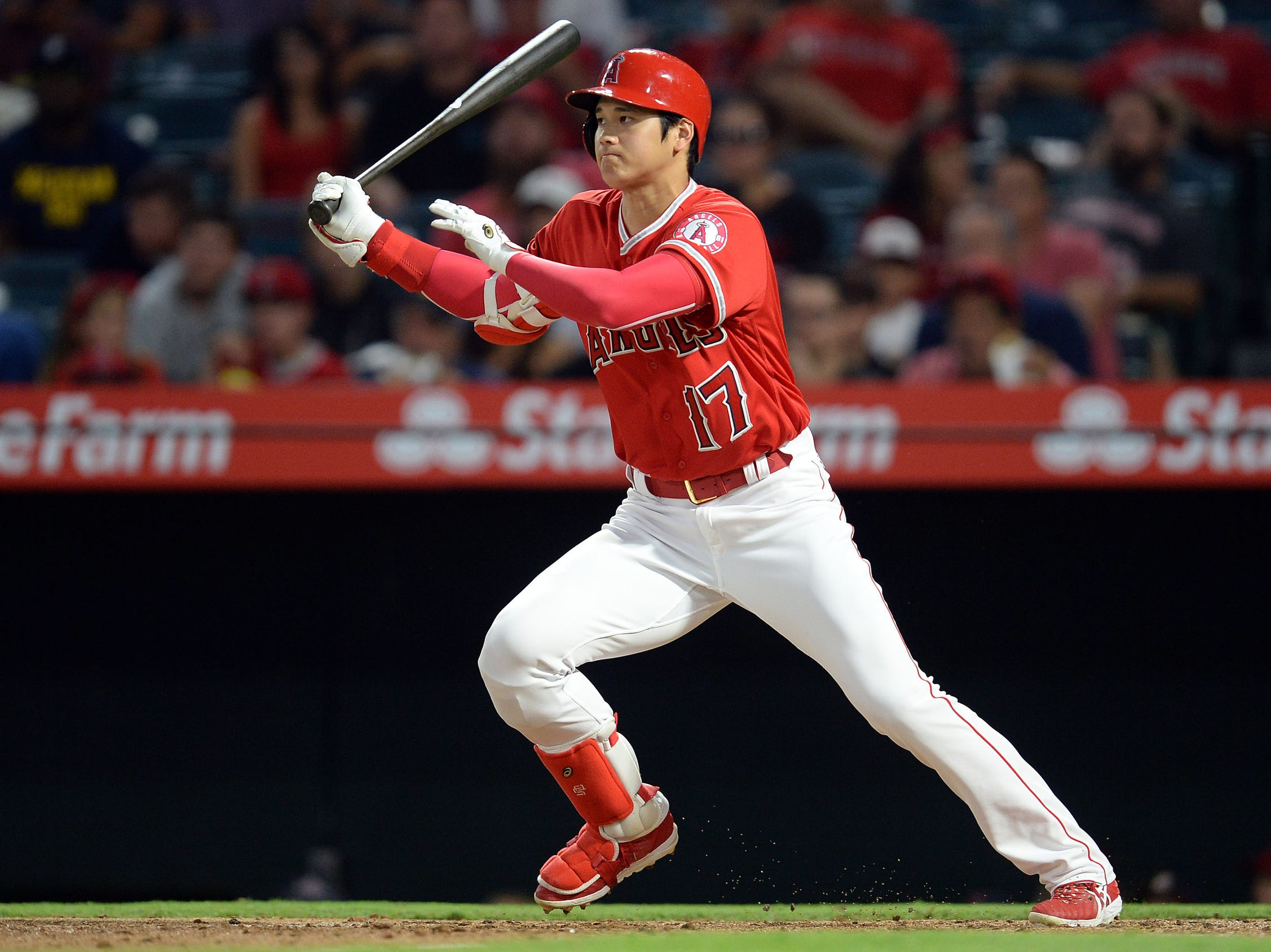 Angels designated hitter Shohei Ohtani hits a single against the Tigers in the second inning on Tuesday, Aug. 7, 2018, in Anaheim, Calif.