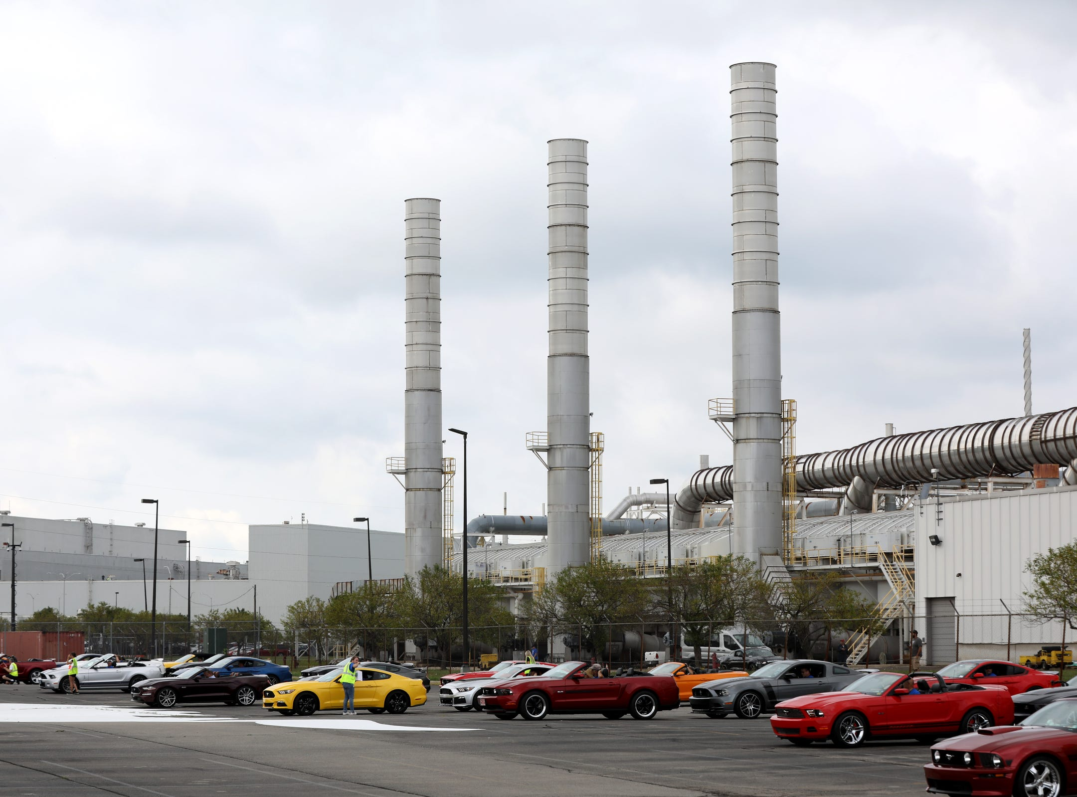 Various Ford Mustangs from the 2000's line up in front of the Flat Rock Assembly plant waiting to move forward to spell out 10 million during the celebration of the 10 millionth Mustang at the Ford Motor Company Flat Rock Assembly Plant in Flat Rock on Wednesday, August 8, 2018