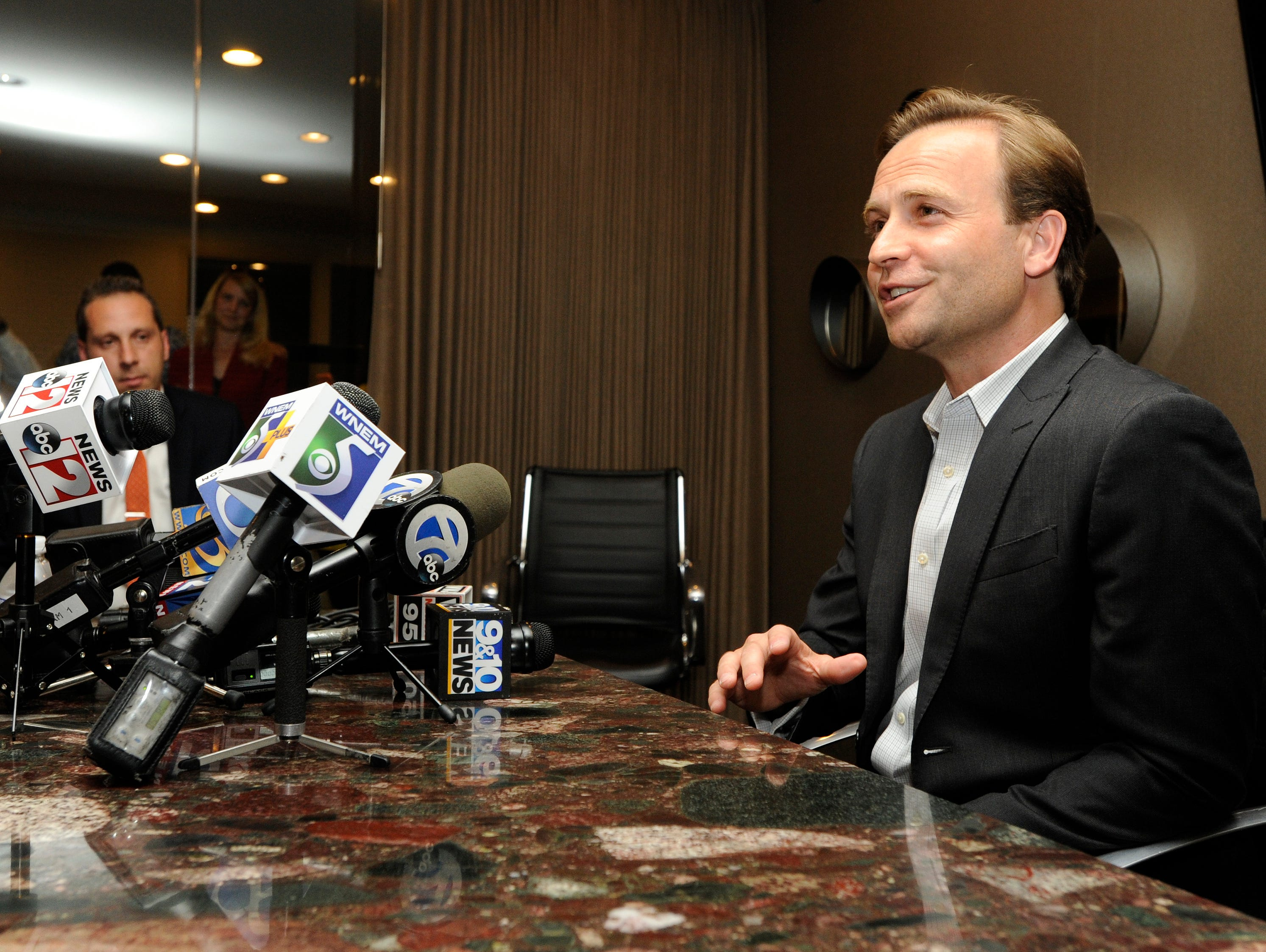 Michigan Lt. Gov. Brian Calley talks to the media during a news conference, Tuesday, Aug. 7, 2018, at Barbat Holdings in West Bloomfield, Mich. Calley is a gubernatorial candidate in Tuesday's primary.