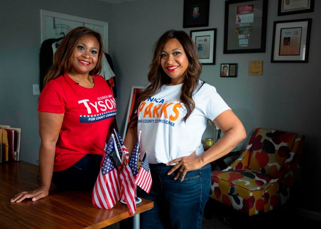 Jessica Ann Tyson, left, and Monica Sparks, twin sisters pose on July 21, 2018, in Kentwood, Michigan.  Sparks and Tyson are twin sisters from Kentwood, Michigan. Both sisters are running for political office in their individual communities. Monica is a Democrat running for County Commissioner in District 12. Jessica is a Republican seeking the County Commissioner position in District 13. While the two hold very different views on the current administration, they have maintained their close bond.