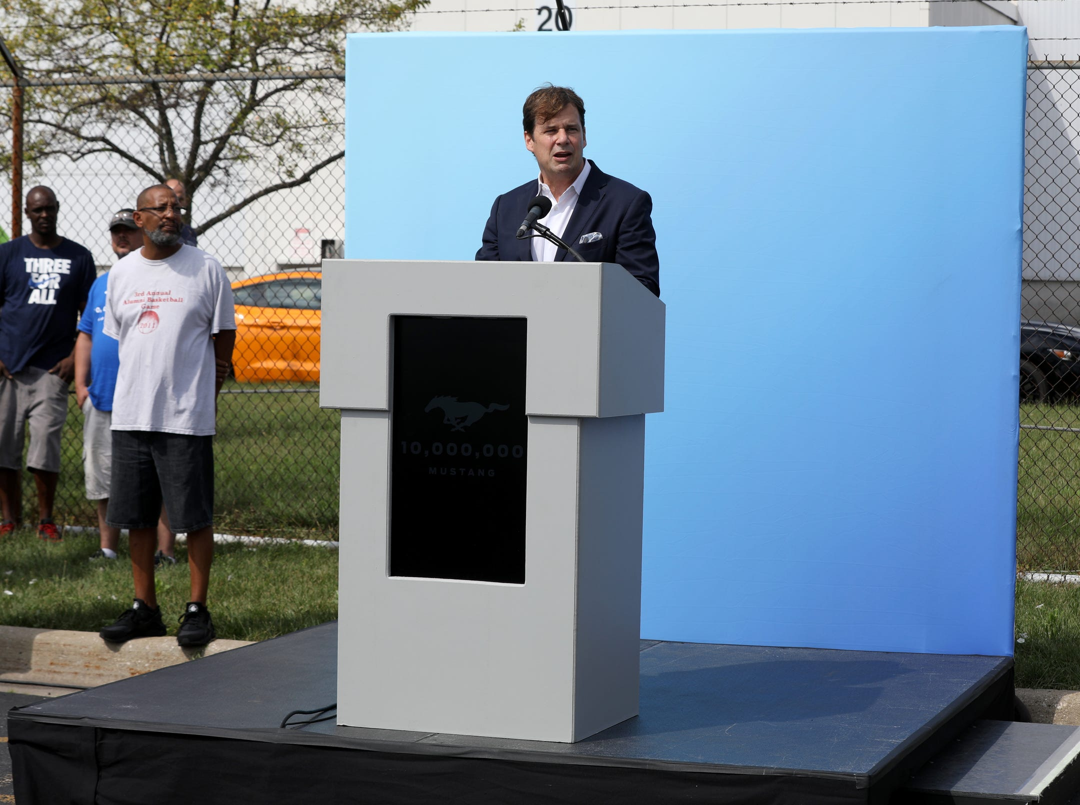 Jim Farley, president of global markets for Ford Motor Company speaks to workers from the Flat Rock Assembly Plant during the celebration of the 10 millionth Mustang built by the Ford Motor Company in Flat Rock on Wednesday, August 8, 2018.