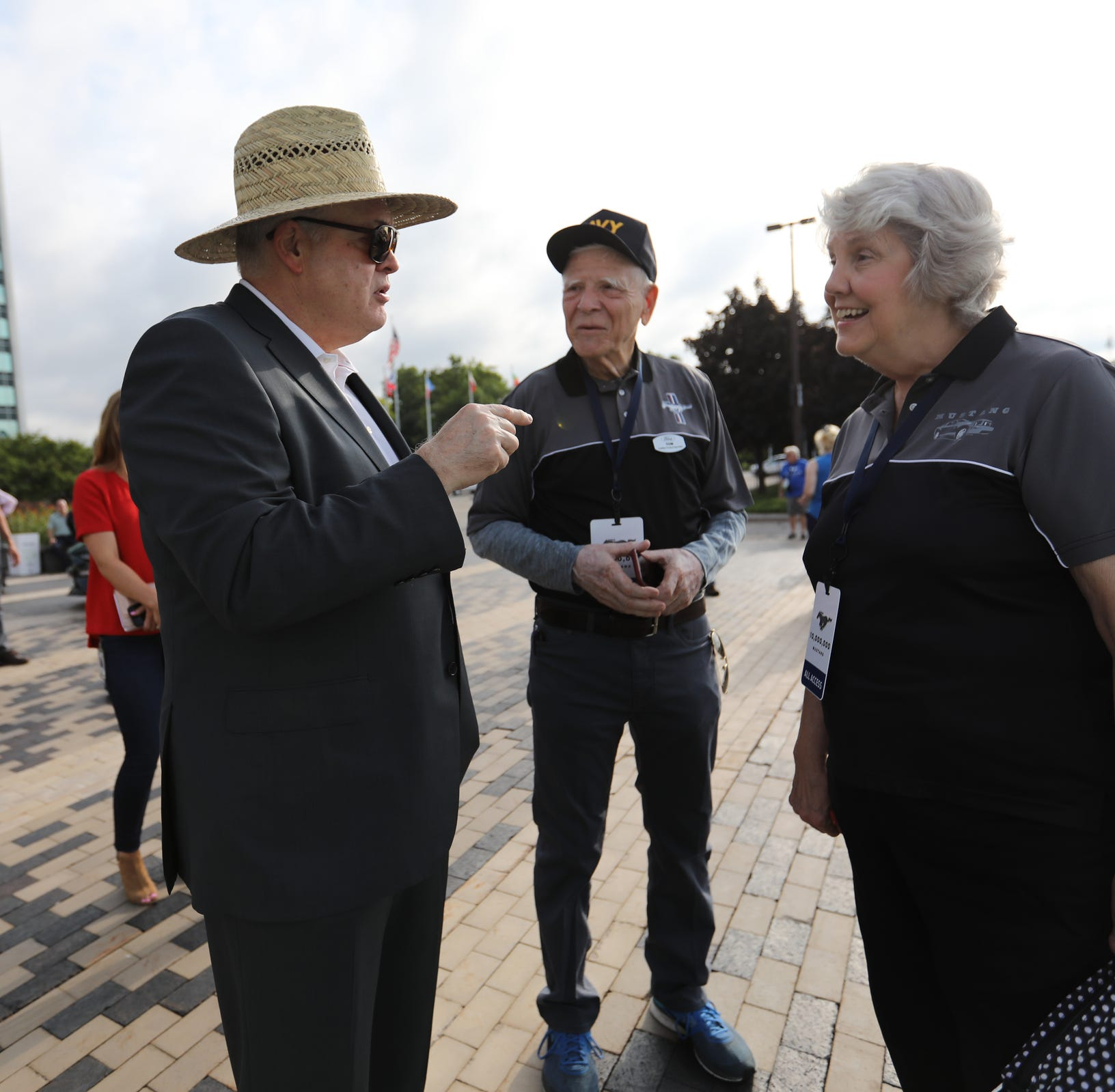Ford Chief Executive Officer James Hackett, left, talks with Tom and Gail Wise, 76, of Park Ridge, Illinois about their 1964 Ford Mustang convertible, during a Ford event celebrating the 10,000,000 Mustang at the Ford Motor Company World Headquarters in Dearborn on Wed., Aug 8, 2018.