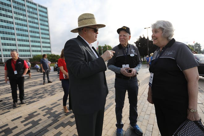 Ford CEO Jim Hackett, left, talks with Tom and Gail Wise of Park Ridge, Illinois about their Ford Mustang convertible, during an event celebrating the 10,000,000th Mustang at the company's world headquarters in Dearborn on Wed., Aug 8, 2018.