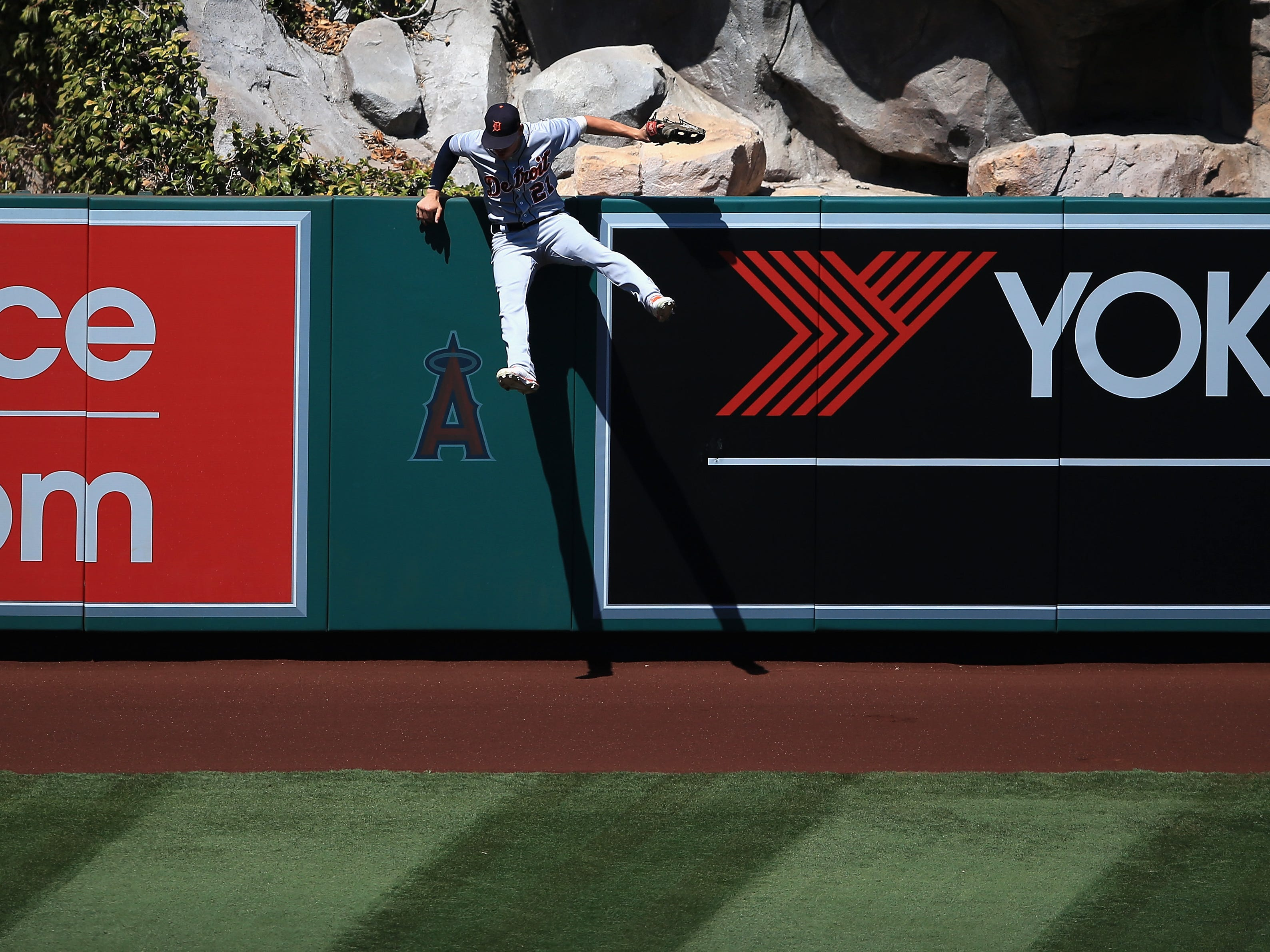 JaCoby Jones of the Detroit Tigers hits the wall trying to catch a solo home run hit by Albert Pujols of the Los Angeles Angels during the fifth inning at Angel Stadium on Aug. 8, 2018 in Anaheim, Calif.
