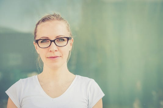 Independent Young Blonde Woman With Eyeglasses Portrait Outdoors