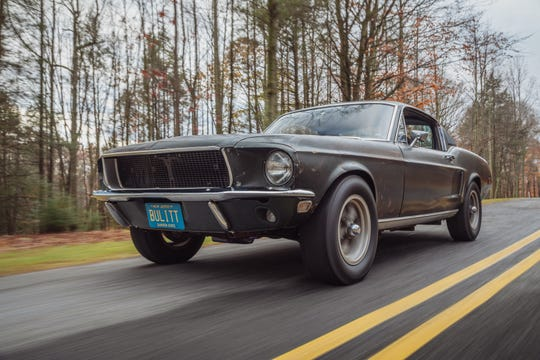 "Sean Kiernan driving his original 1968 Mustang that starred in the movie ""Bullitt."""