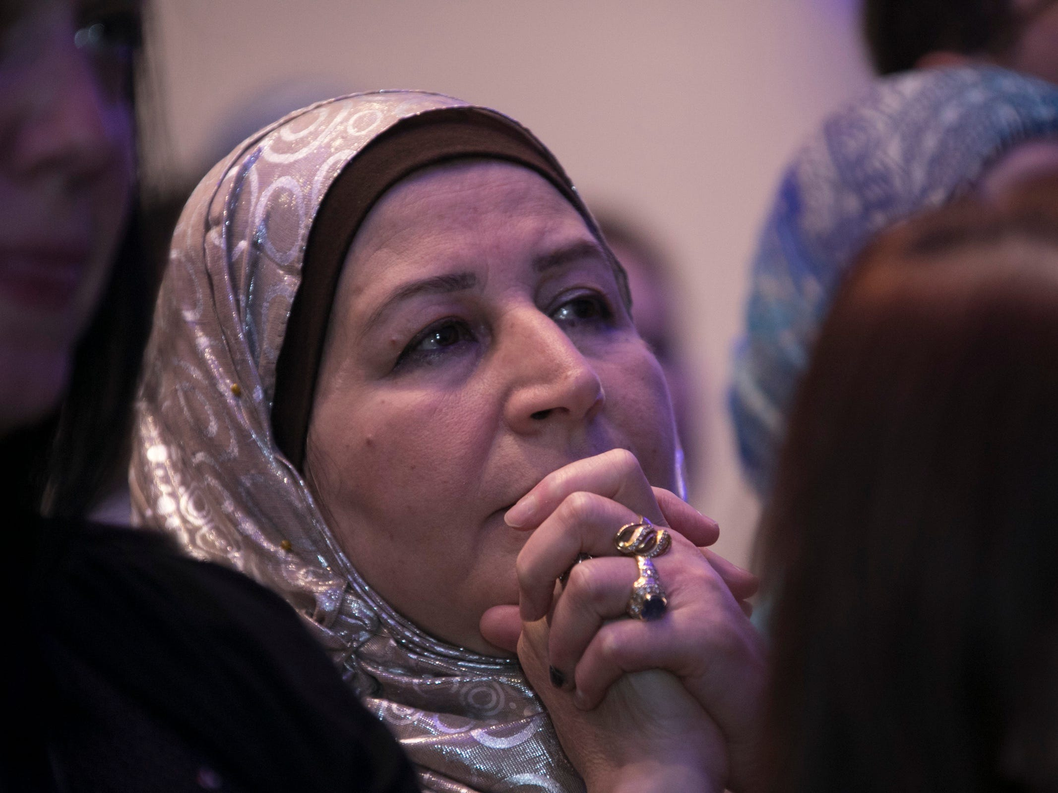 Ebtessam Abazed clasps her hands as Democratic gubernatorial candidate Abdul El-Sayed speaks to supporters at the Grand Riverview Ballroom at Cobo Center in Detroit Tuesday, August 7, 2018.