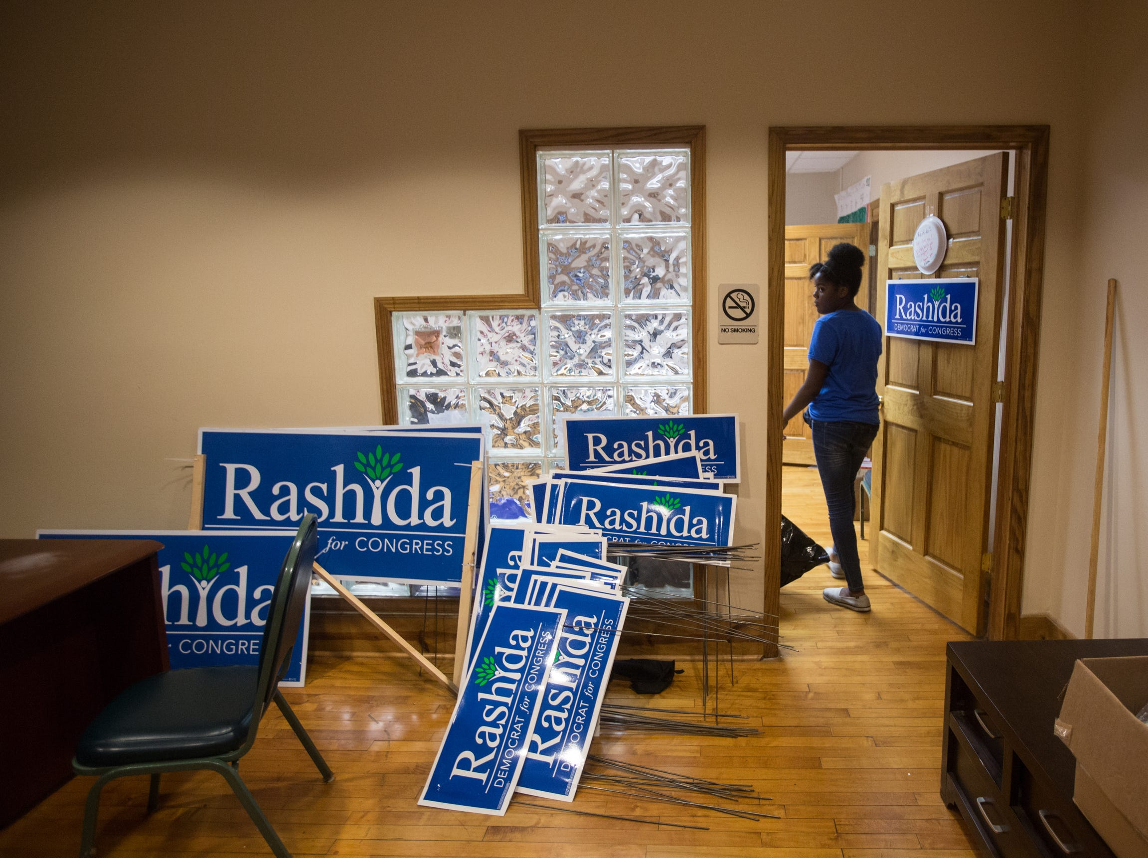 A volunteer enters a room at one of Rashida Tlaib's field offices after Rashida Tlaib's election night party in Northwest Detroit on Aug. 7, 2018.