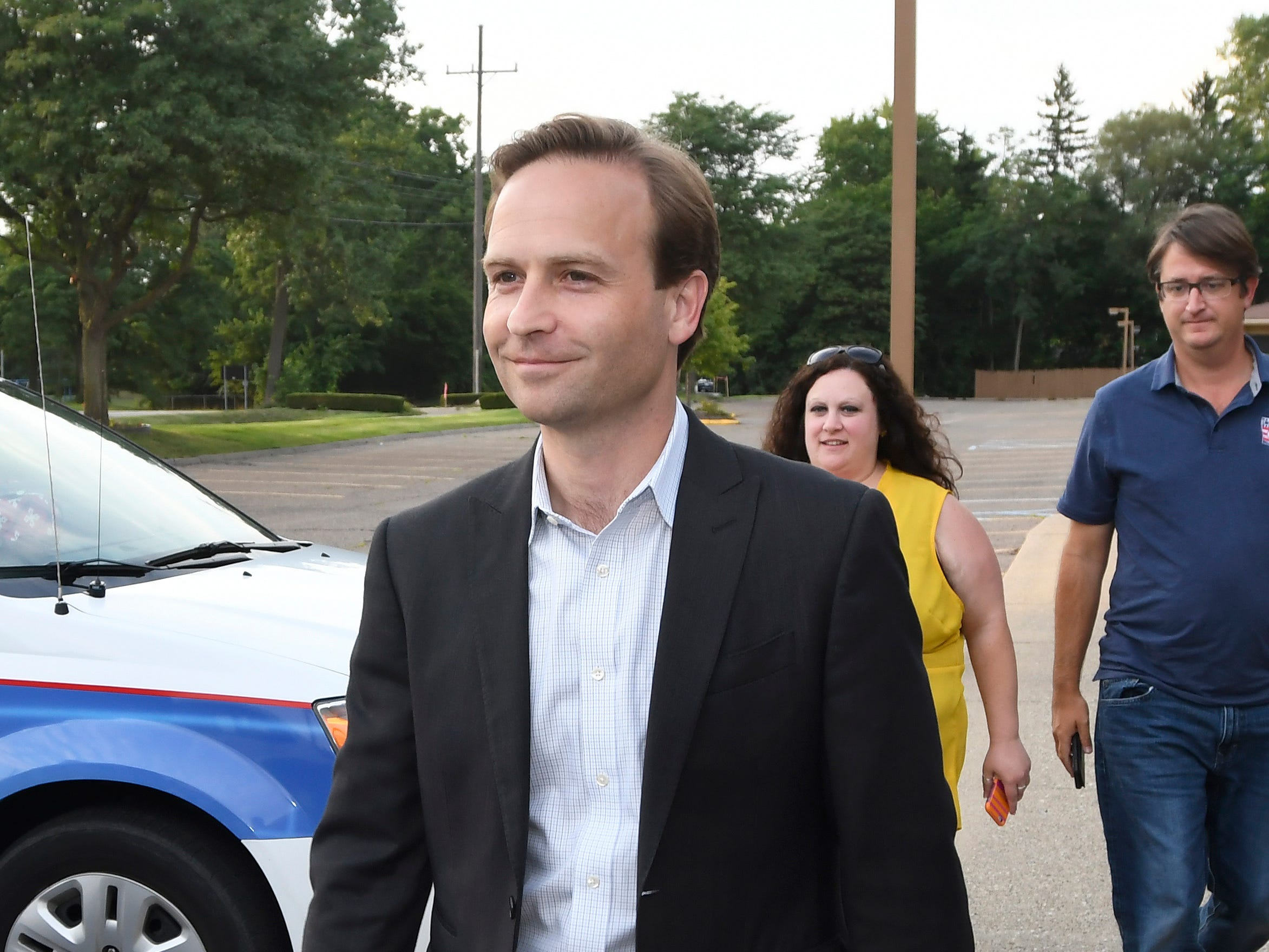 Michigan Lt. Gov. Brian Calley walks to a news conference held at Barbat Holdings, Tuesday, Aug. 7, 2018 in West Bloomfield, Mich. Calley is a gubernatorial candidate in Tuesday's primary.
