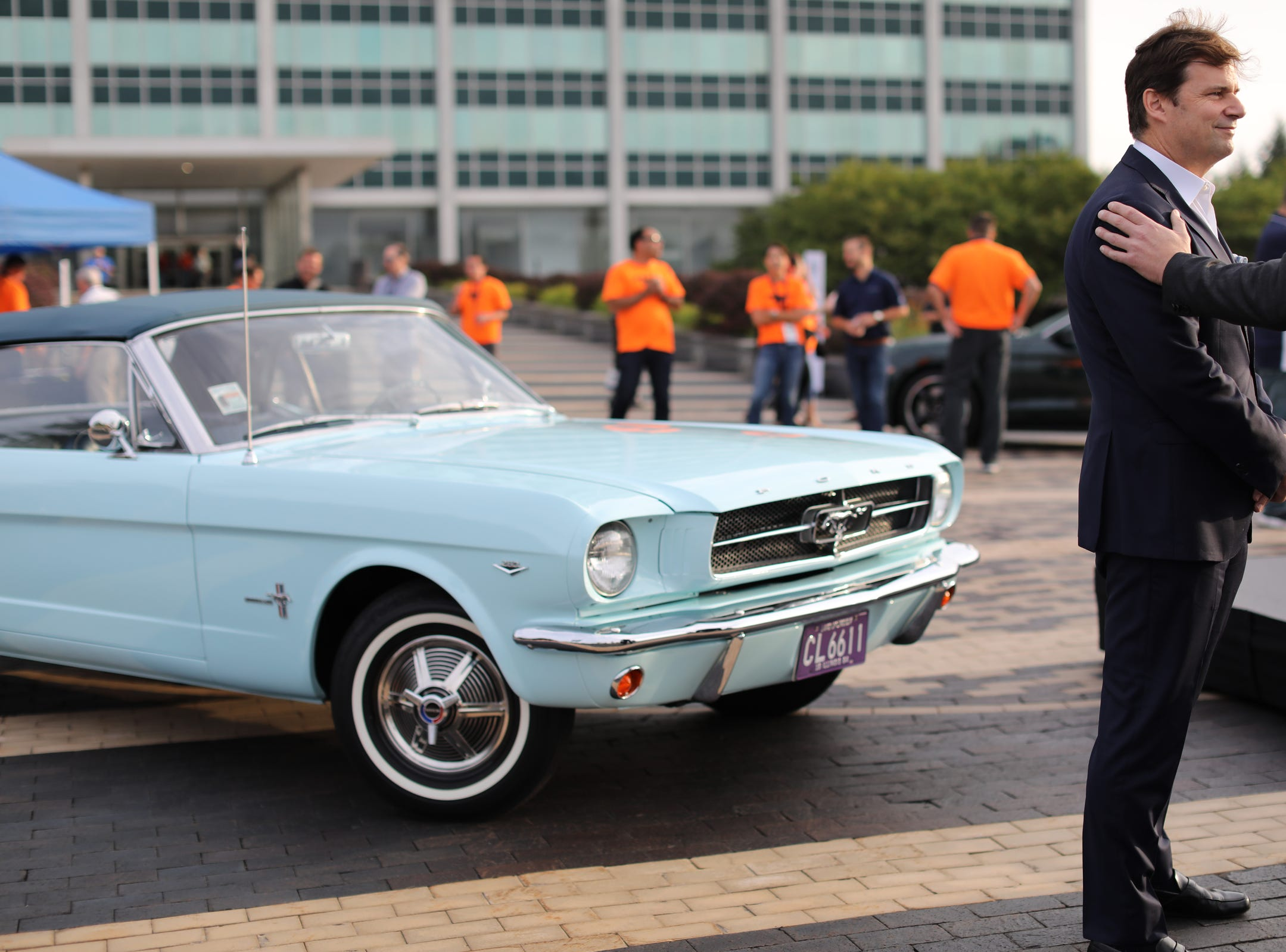 James D. Farley Jr., Executive Vice President and President, Global Markets, Ford Motor Company, is interviewed by the media in front of Gail Wise's 1964 Ford Mustang convertible, during a Ford event celebrating the 10,000,000 Mustang at the Ford Motor Company World Headquarters in Dearborn on Wed., Aug 8, 2018.