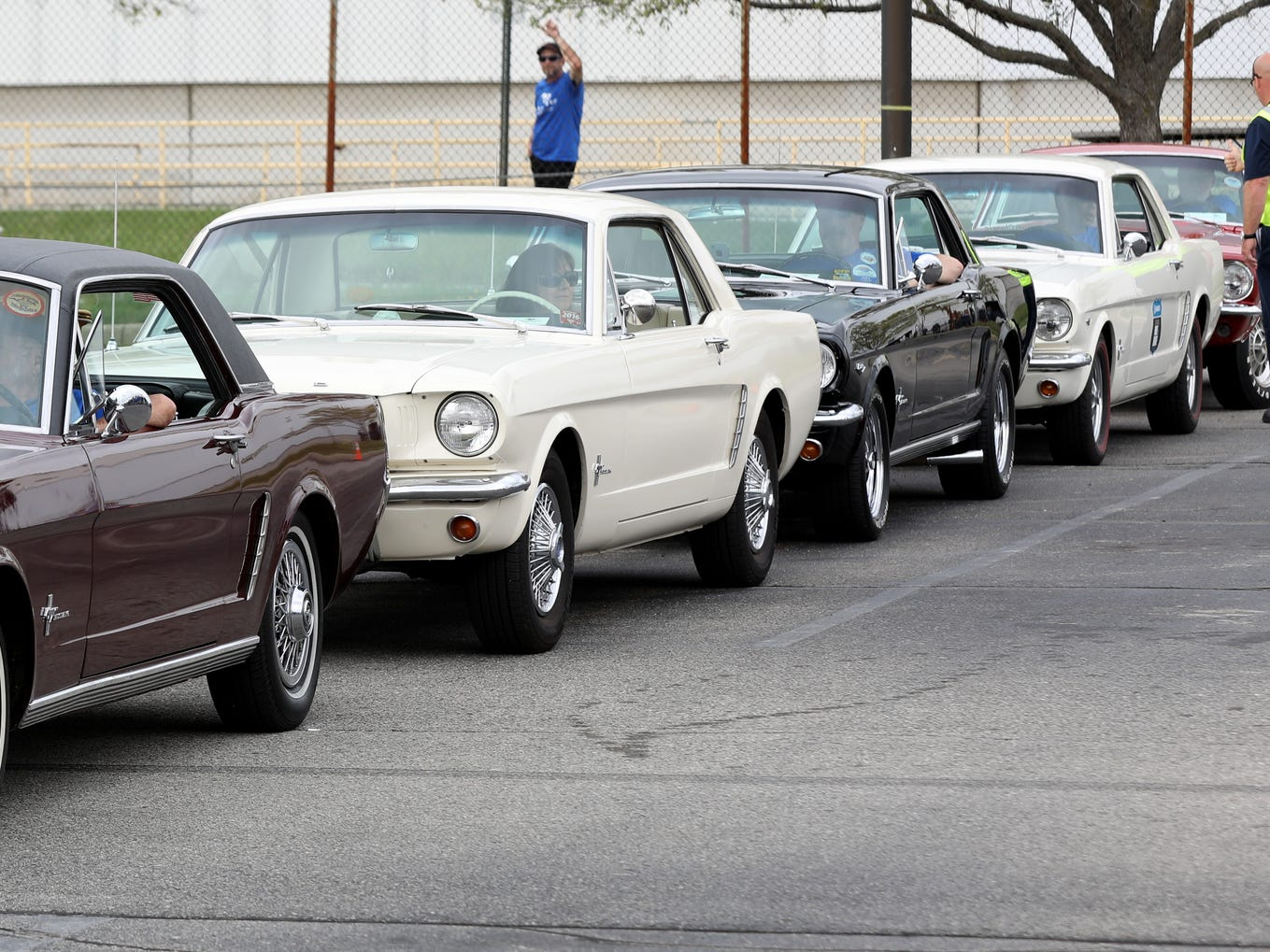 Ford Mustangs from the 1960s line up during the celebration of the 10 millionth Mustang at the Ford Flat Rock assembly plant on Wednesday, Aug. 8, 2018.
