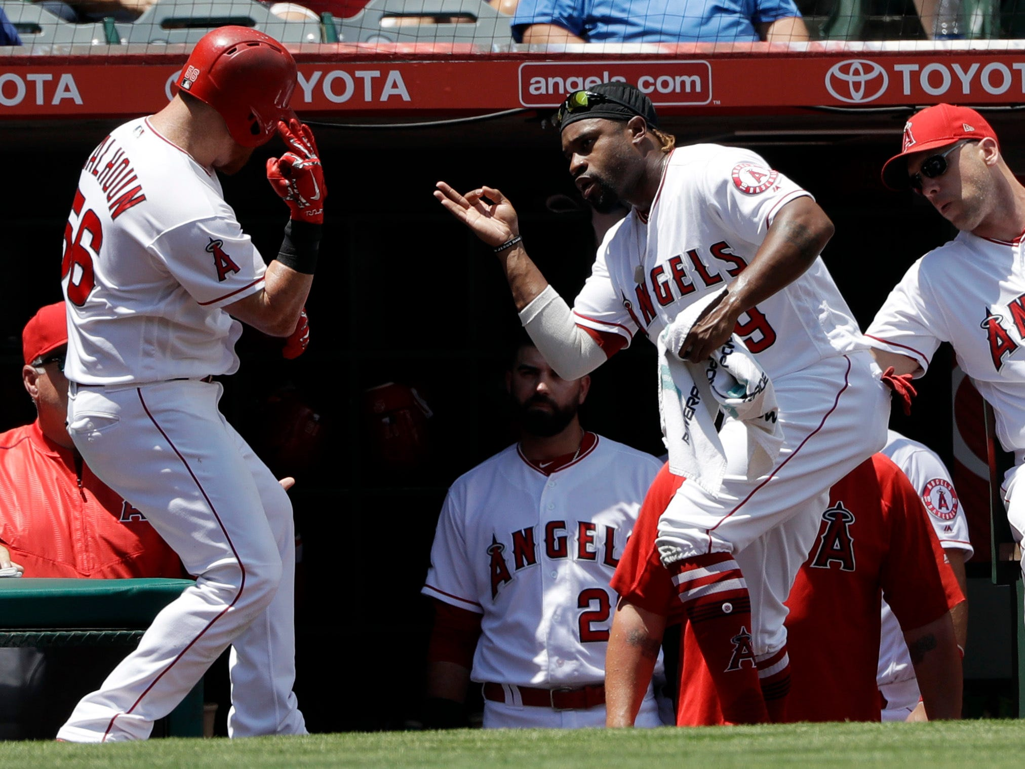 Los Angeles Angels' Kole Calhoun, left, celebrates his solo home run with teammate Nicolas Castellans during the first inning of a baseball game against the Detroit Tigers, Wednesday, Aug. 8, 2018, in Anaheim, Calif.