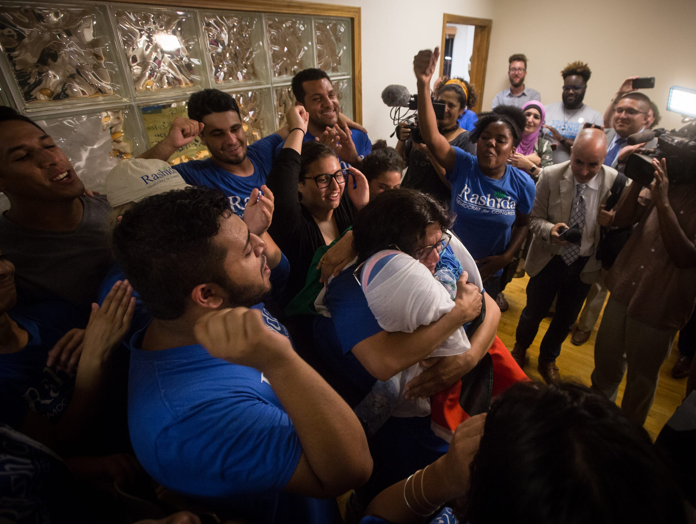 Rashida Tlaib celebrates and hugs her mother, Fatima Elabed, after winning the Democratic Primary in Michigan's 13th District at one of Tlaib's field offices in Northwest Detroit on Aug. 7, 2018.