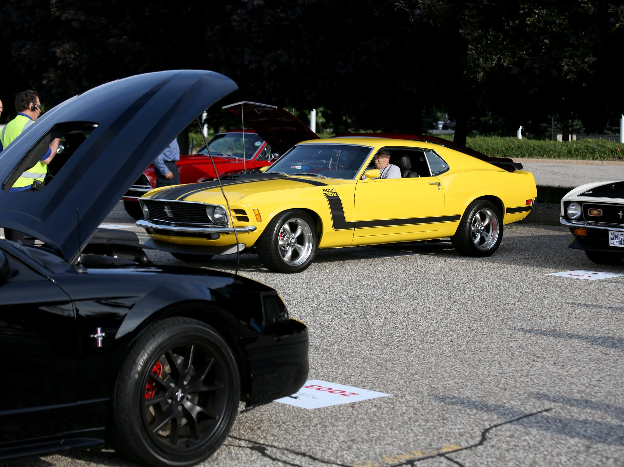 A 1970 Ford Mustang Boss 302 pulls into a spot, during a Ford event celebrating the 10,000,000 Mustang built at the Ford Motor Company World Headquarters in Dearborn on Wed., Aug 8, 2018.