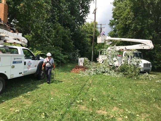 Workers from DTE Energy repair downed wires in Detroit's Jefferson-Chalmers neighborhood adjoining Grosse Pointe Park. Power was out on both sides of the municipal border following Monday's storm.