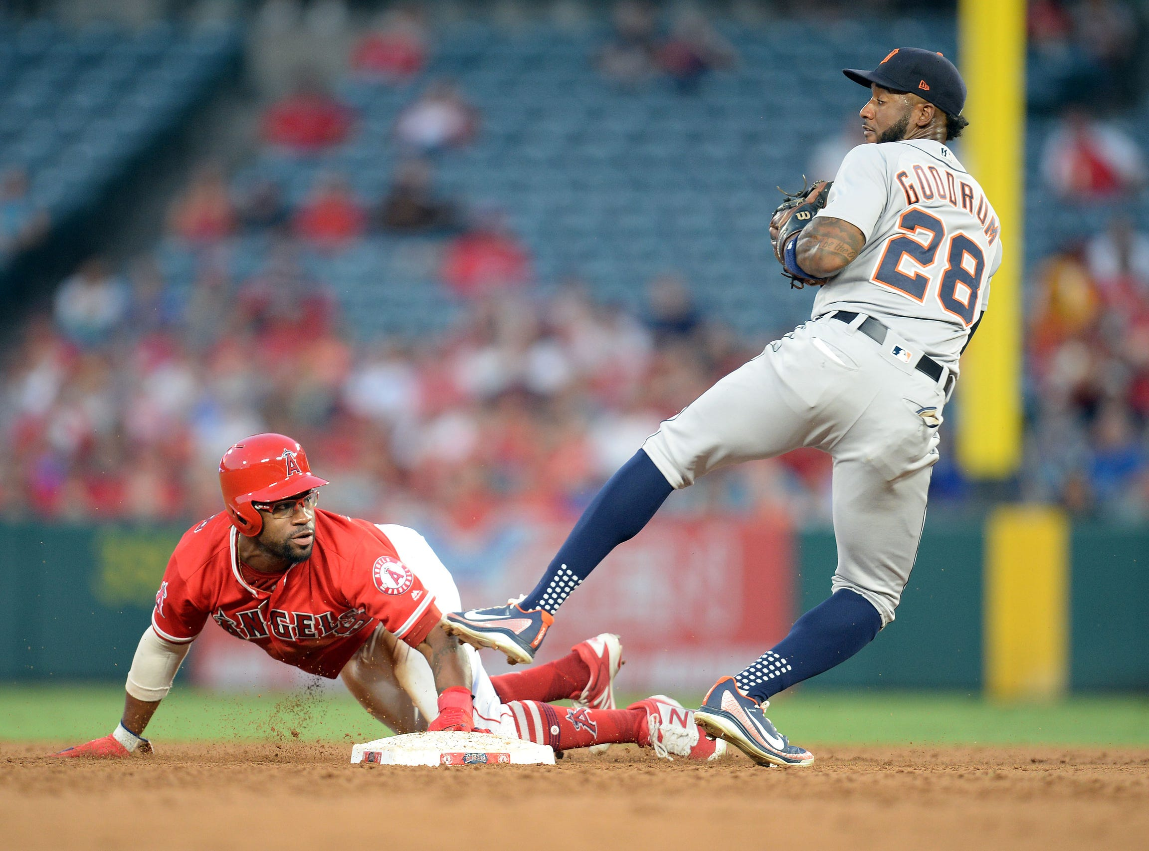 Angels left fielder Eric Young Jr. steals second against Tigers second baseman Niko Goodrum in the first inning on Tuesday, Aug. 7, 2018, in Anaheim, Calif.