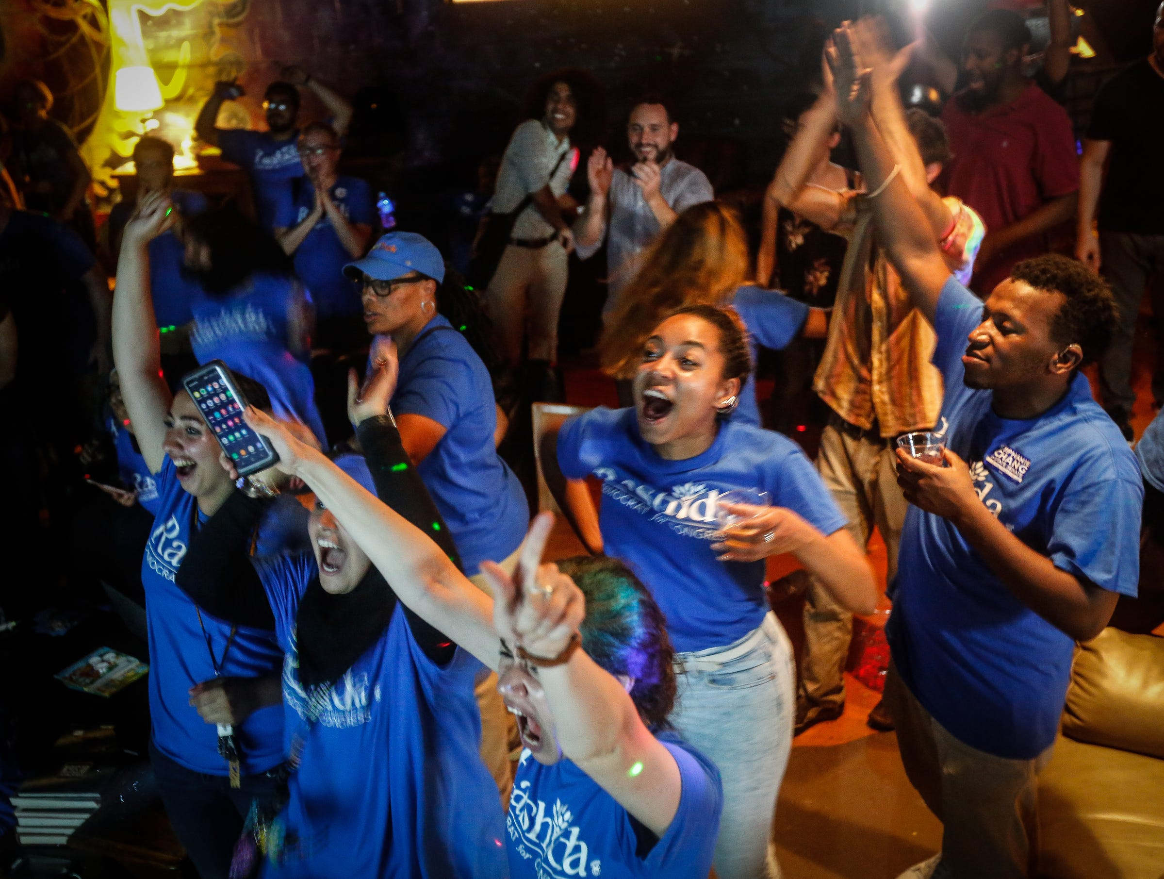 Supporters of Rashida Tlaib celebrate after the Associated Press called Tlaib's race in her favor at Tlaib's election night party in Northwest Detroit on Aug. 7, 2018.