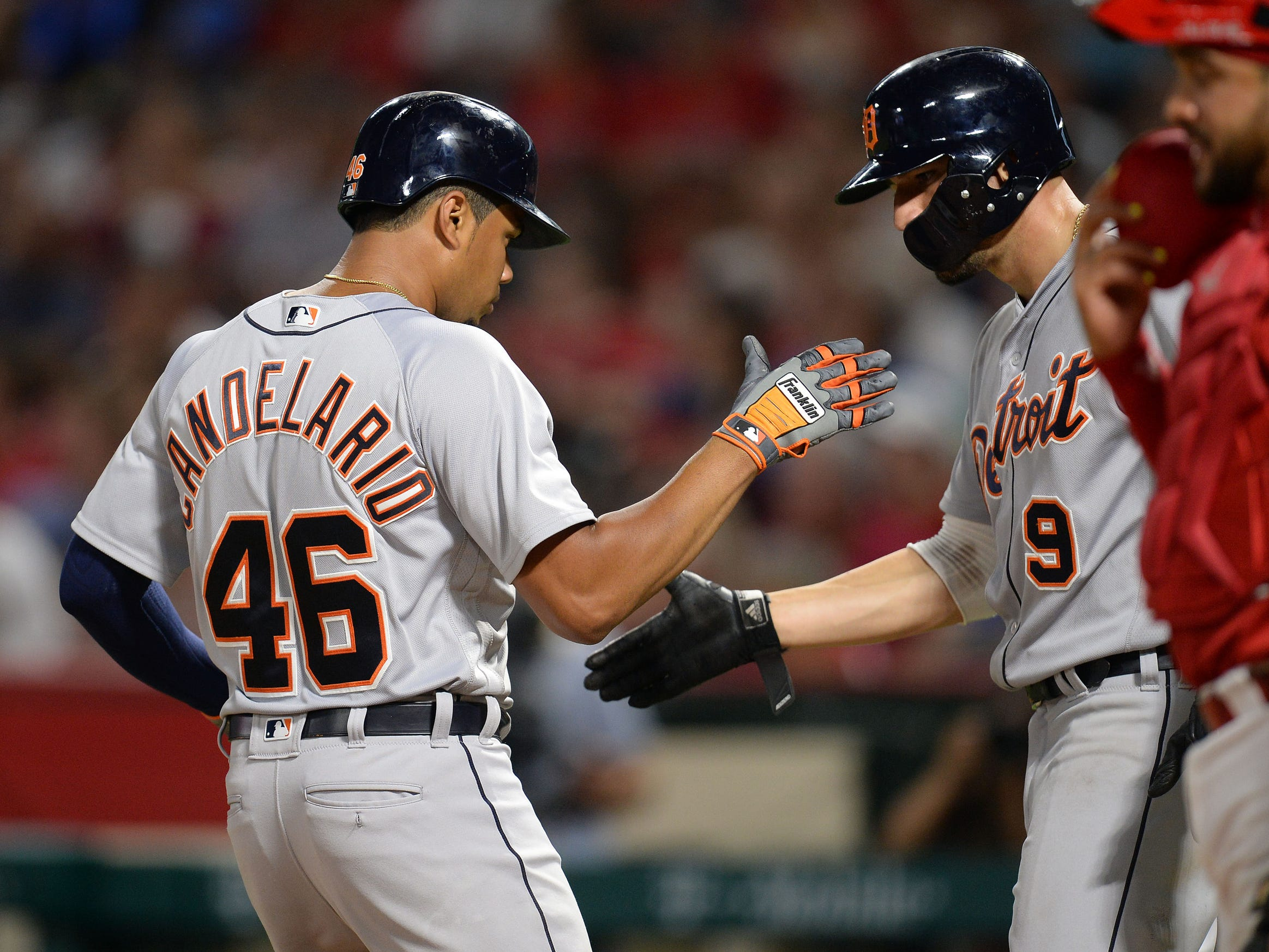 Tigers third baseman Jeimer Candelario is greeted by right fielder Nicholas Castellanos after hitting a two-run home run in the fifth inning on Tuesday, Aug. 7, 2018, in Anaheim, Calif.