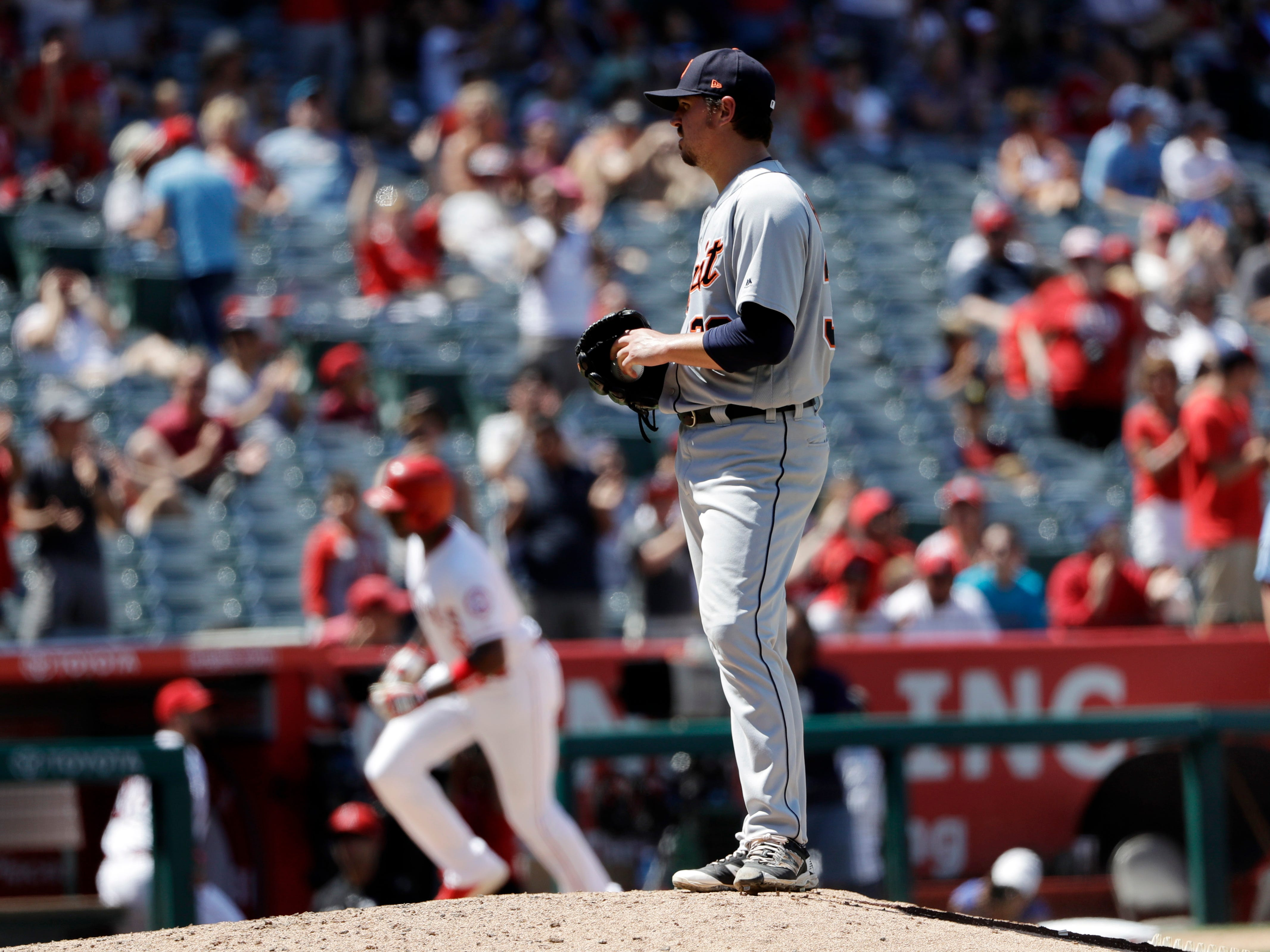 Detroit Tigers starting pitcher Blaine Hardy stands on the mound after giving up a two-run home run to Los Angeles Angels' Justin Upton, left, during the fifth inning of a baseball game Wednesday, Aug. 8, 2018, in Anaheim, Calif.