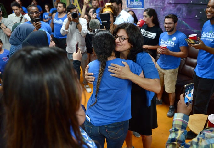 Rashida Tlaib greets family and supporters at the MotorCity Java House in Detroit on Aug. 7, 2018.