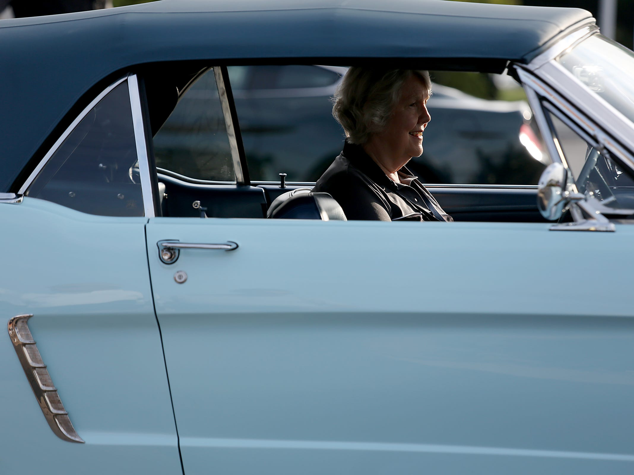 Gail Wise, 76, of Park Ridge, Illinois is the first buyer of a Ford Mustang and sits in the 1964 Mustang she purchased during a Ford event celebrating the 10,000,000 Mustang built at the Ford Motor Company World Headquarters in Dearborn on Wed., Aug 8, 2018.