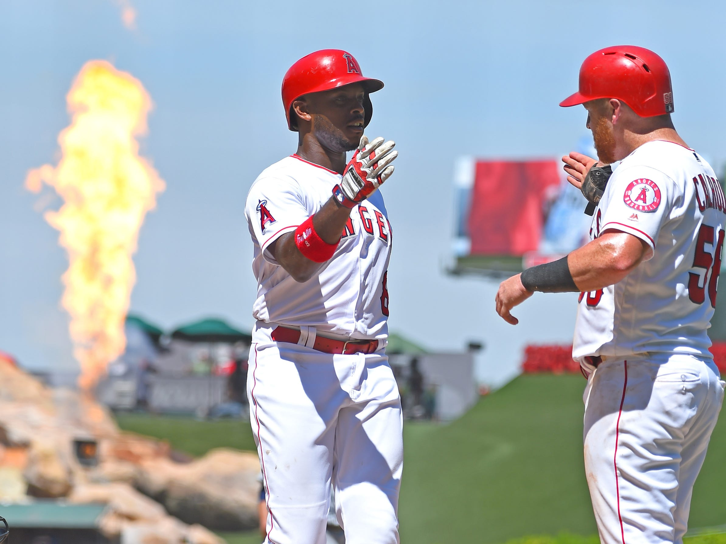Los Angeles Angels left fielder Justin Upton (8) is greeted by Los Angeles Angels right fielder Kole Calhoun (56) after a two run home run in the fifth inning against the Detroit Tigers at Angel Stadium of Anaheim on August 8, 2018.