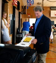 Sandy Pensler, Michigan Republican candidate for the U.S. Senate, casts his vote in the Michigan Primary election while his daughter Natasha, watches at Trombly School August 7, 2018 in Grosse Pointe Park.