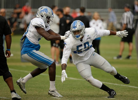 Lions RB Kerryon Johnson, left, and LB Darnell Sankey during practice Aug. 8 in Napa, Calif.