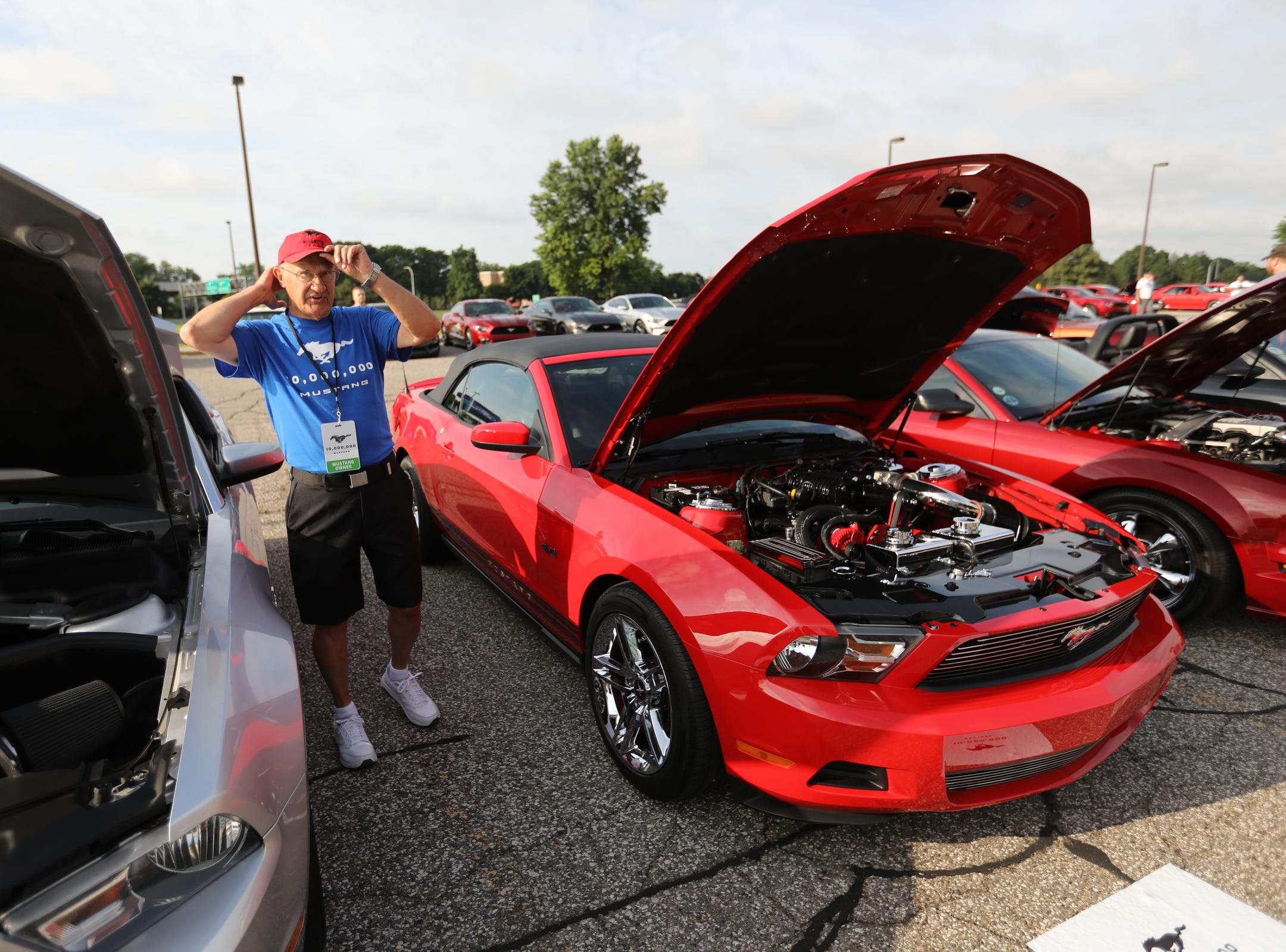 Rick Pidsosny, 69, of Canton says he has spent more money on restoring his 2010 Ford Mustang convertible than it cost to buy the previous rental car, during a Ford event celebrating the 10,000,000 Mustang built at the Ford Motor Company World Headquarters in Dearborn on Wed., Aug 8, 2018.