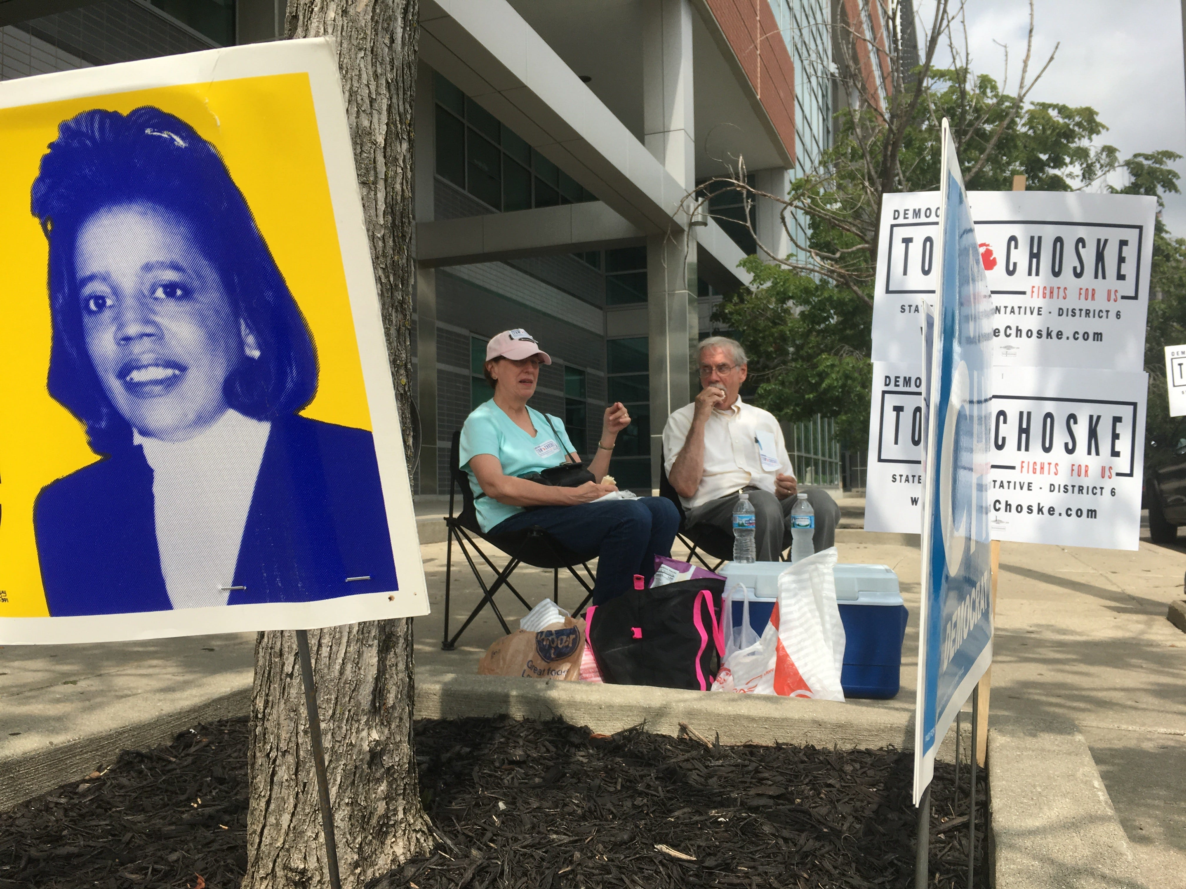 """Evelyn Choske, 67, of Dearborn picnics with her husband Frank Choske, 70, Tuesday, Aug. 7, 2018, outside Cass Tech. High School as they stump for their Son Tom Choske who is running for State Representative in 6th District. """"It's a crowded field"""" said his mom """"it's going to be tight."""""""