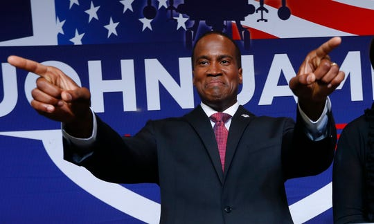 Republican U.S. Senate candidate John James arrives at a primary night election party in Detroit, Tuesday, Aug. 7, 2018.
