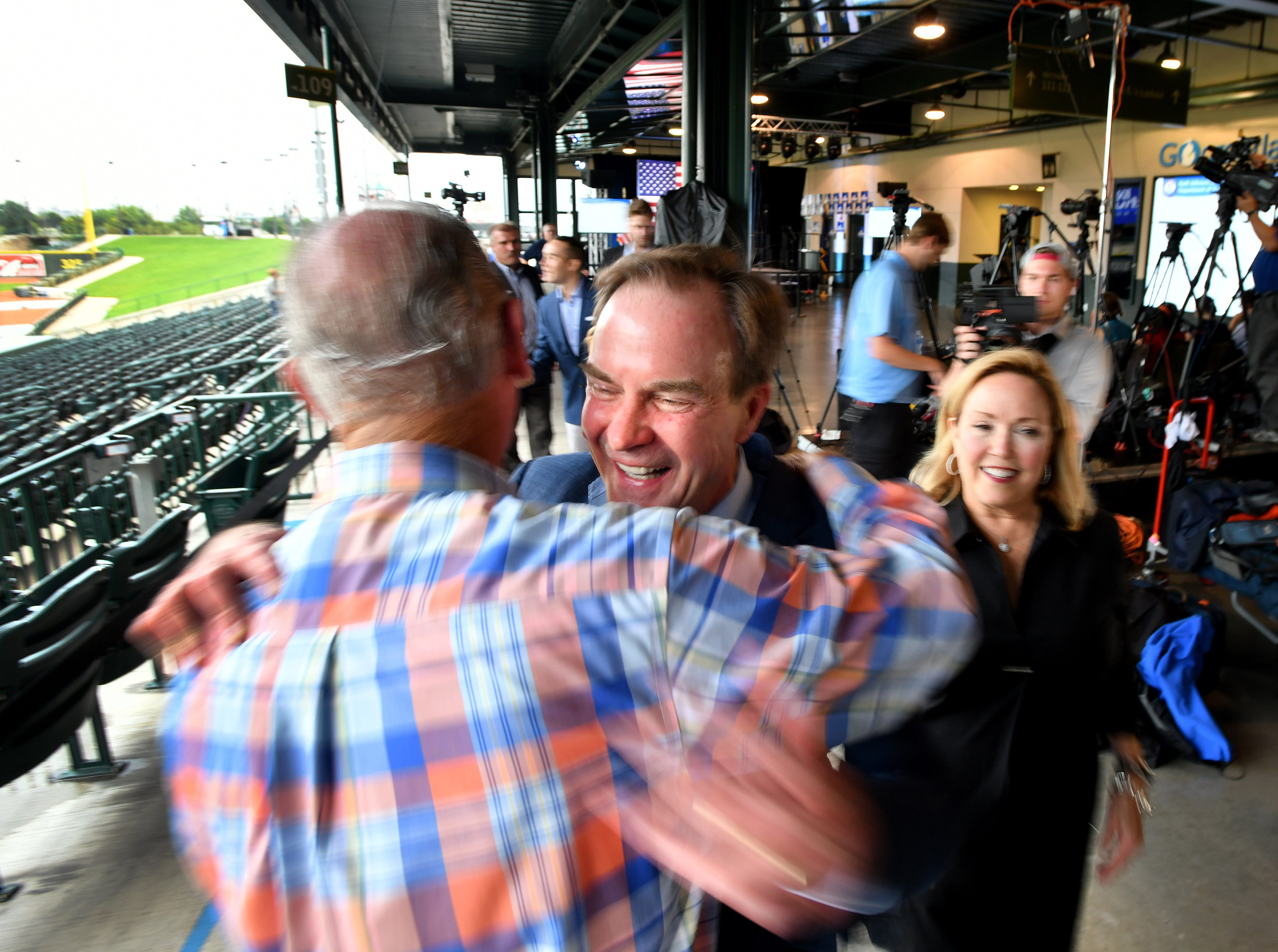 Michigan Attorney General Bill Schuette and his family greet supporter Jim Barrett  at Schuette's post-election event  at Dow Diamond, the home of Midland's minor league baseball team