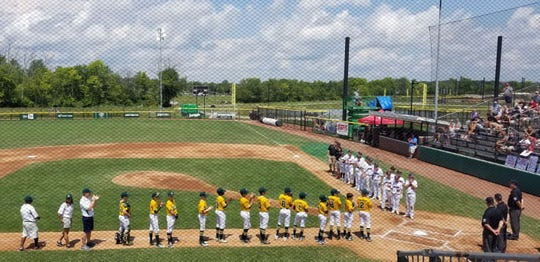 The Grosse Pointe Woods-Shores team lines up prior to Wednesday's game against Indiana.