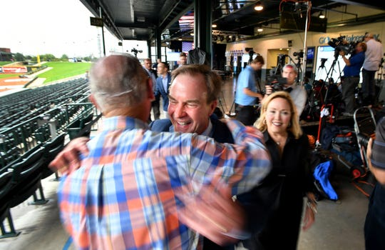 Michigan Attorney General Bill Schuette and his family greet supporter Jim Barrett  before the polls close on primary election day, Aug 7, 2018.  Schuette's post-election event is being held at Dow Diamond, the home of Midland's minor league baseball team.