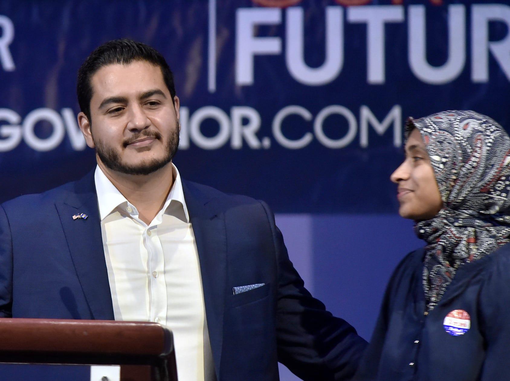 Dr. Abdul El-Sayed, left, begins to speak after kissing his wife, Dr. Sarah Jukaku.