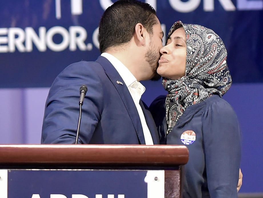 Dr. Abdul El-Sayed, left, kisses his wife, Dr. Sarah Jukaku, before he speaks.