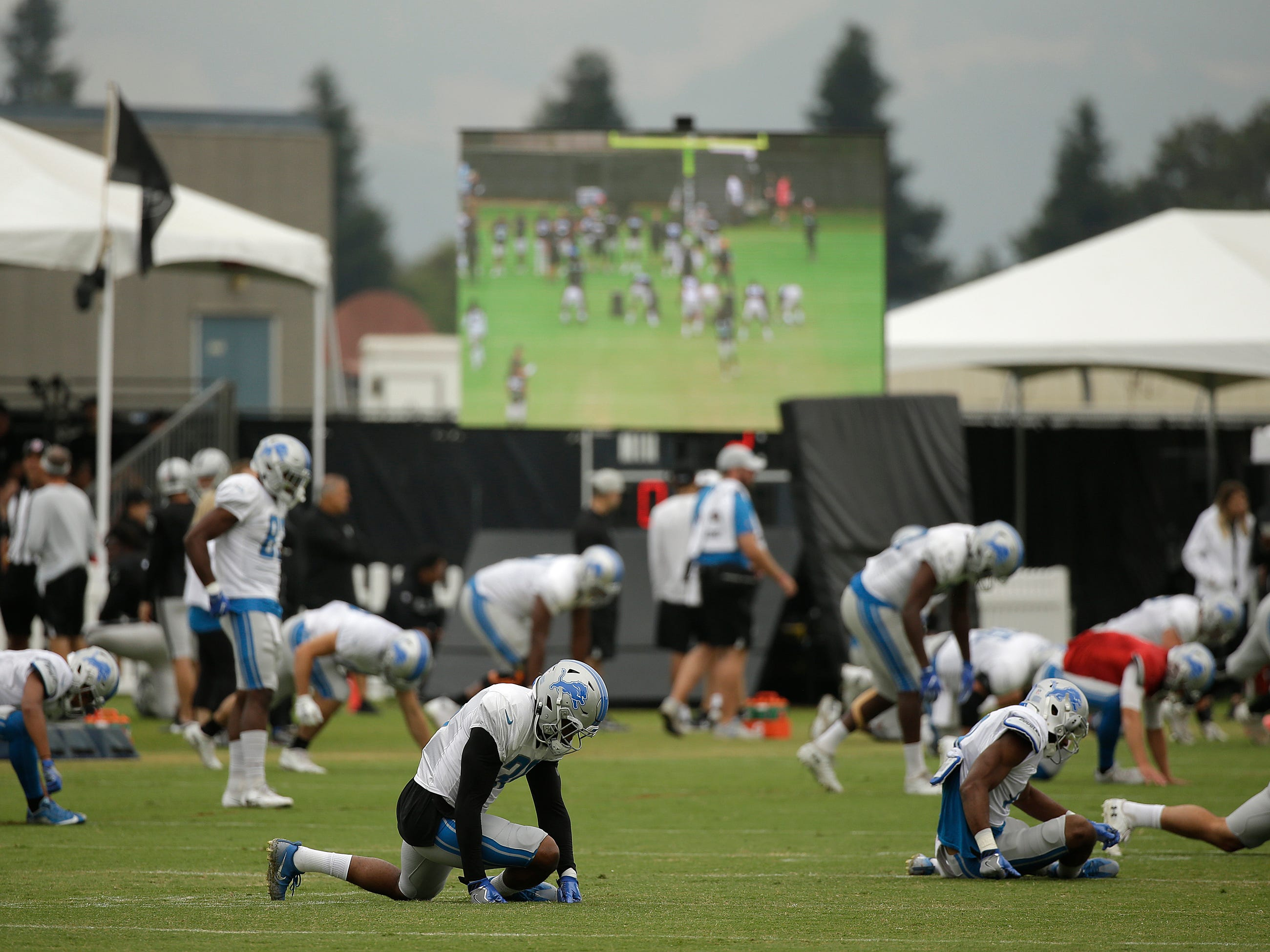 The Detroit Lions stretch at the start of practice.