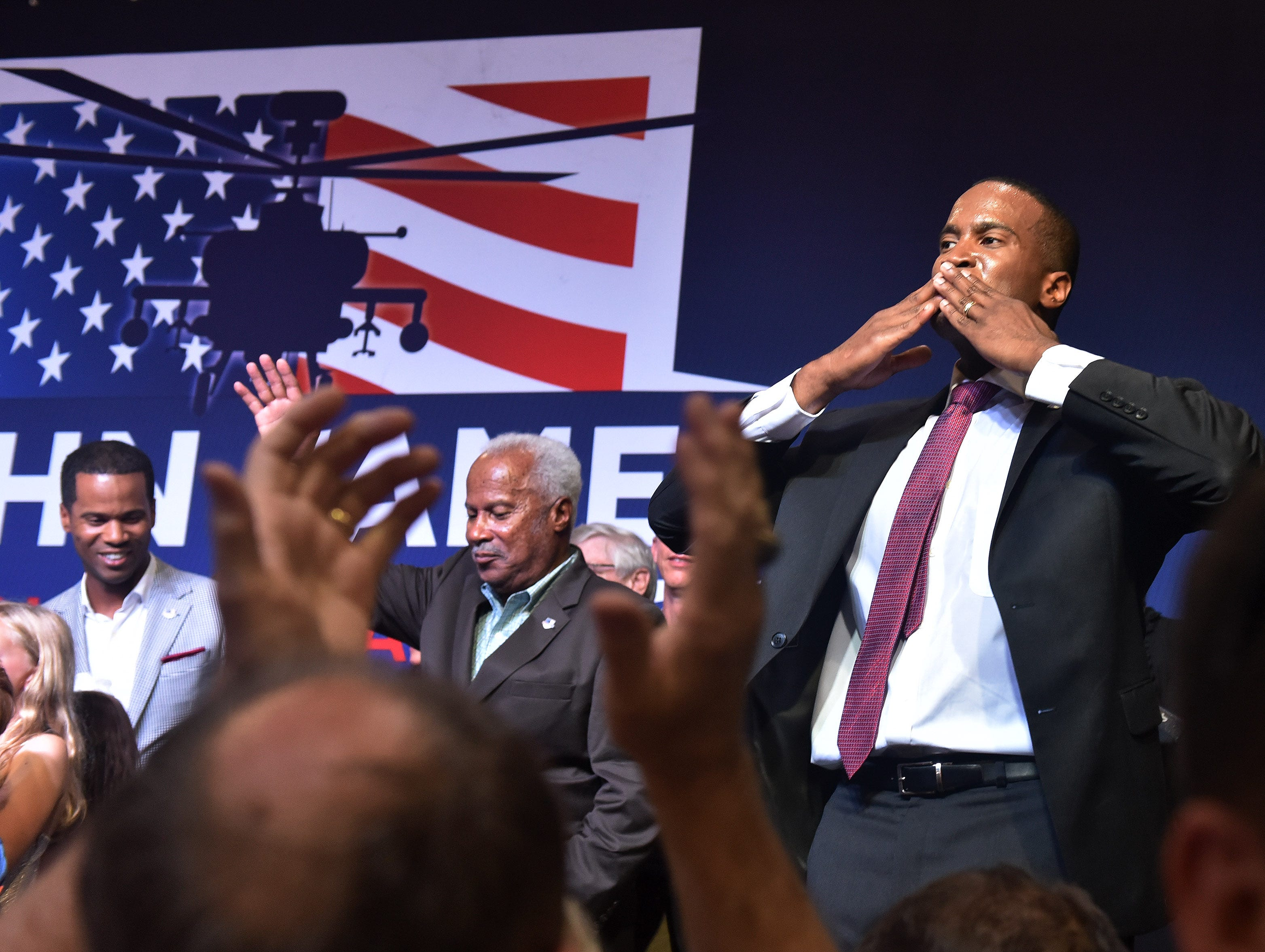 Republican Senate candidate John James blows a kiss to his supporters at his election night party at James Group International in Detroit on Aug. 7, 2018.