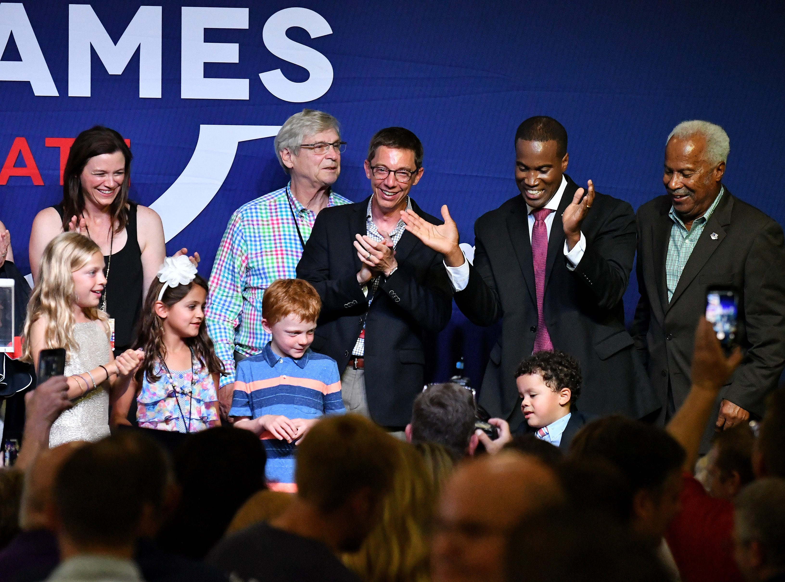 Republican senate candidate John James, second from right, dances with family and friends on the stage afer he speaks at the election night party.