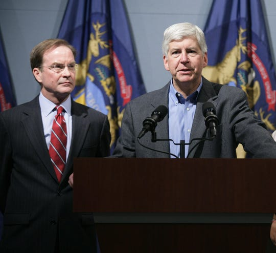 Former Gov. Rick Snyder, right, with former state Attorney General Bill Schuette.