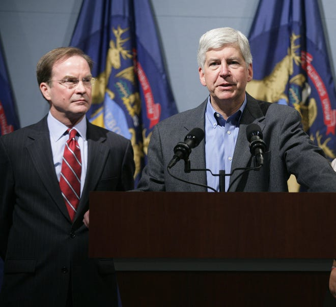 The unity Michigan Republicans will likely tout at this weekend's party convention doesn't reflect the sharp divide between its de facto leaders, Attorney General Bill Schuette, left, and Gov. Rick Snyder.