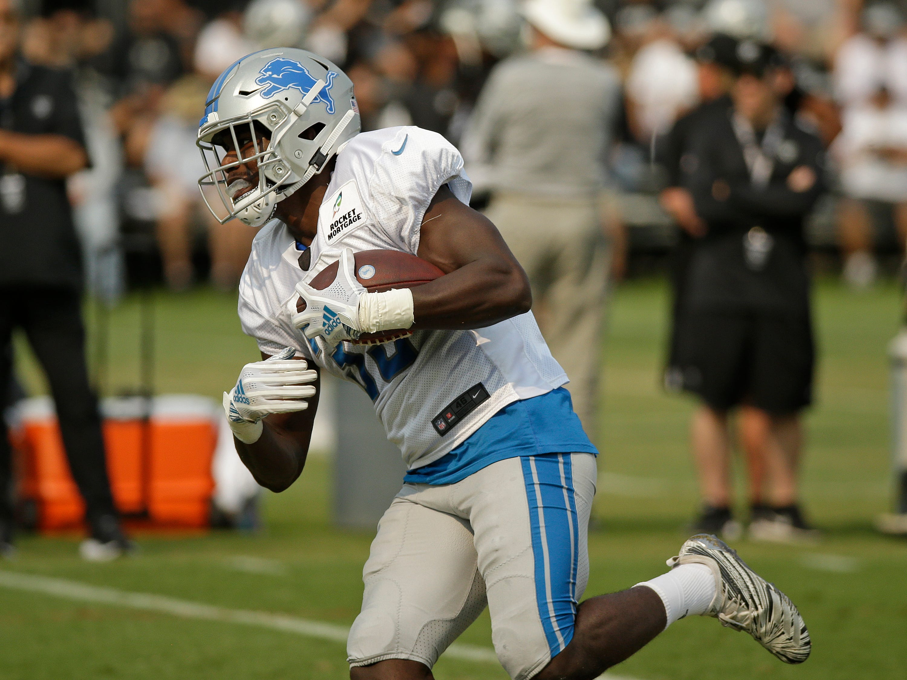 Lions running back Kerryon Johnson carries the ball.