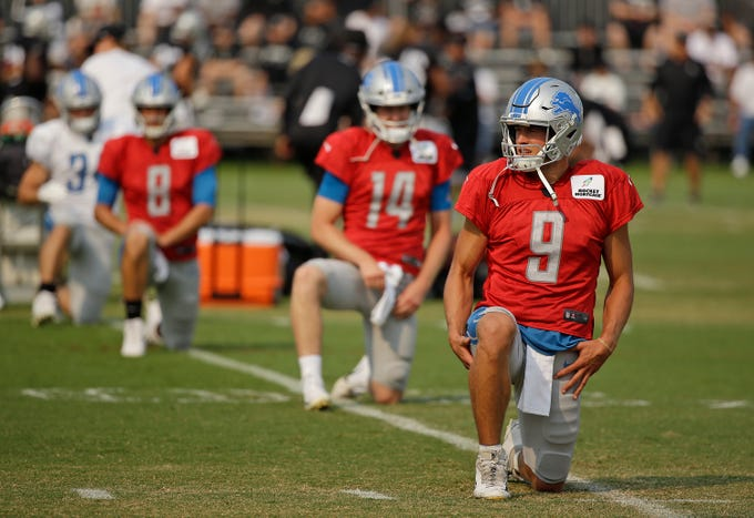 Detroit Lions quarterbacks Matthew Stafford (9), Jake Rudock (14) and Matt Cassel (8) stretch during NFL football practice Tuesday, Aug. 7, 2018, in Napa, Calif. Both the Oakland Raiders and the Detroit Lions held a joint practice before their upcoming preseason game on Friday.