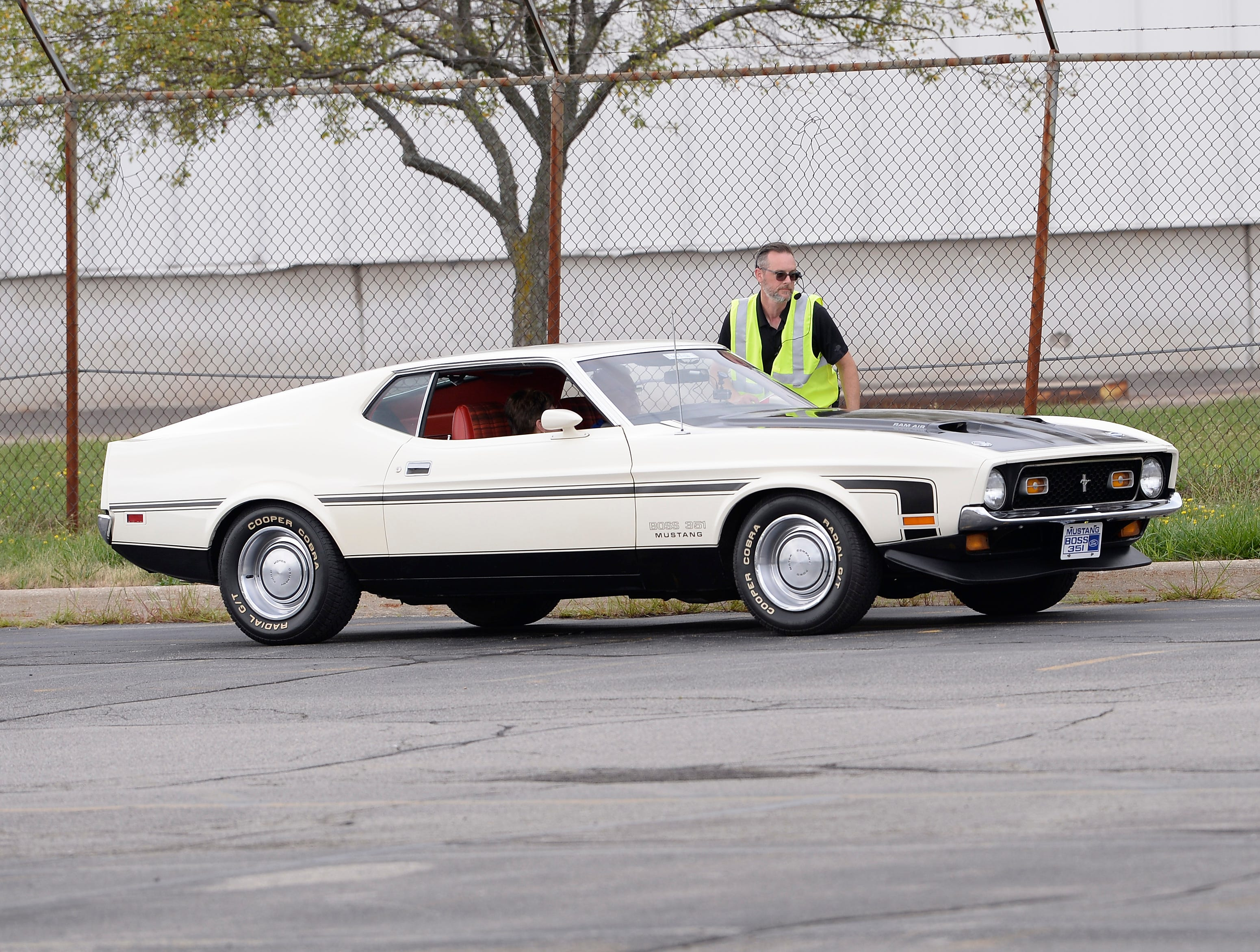 A 1971 Mustang Boss 351 waits for the start of the parade.