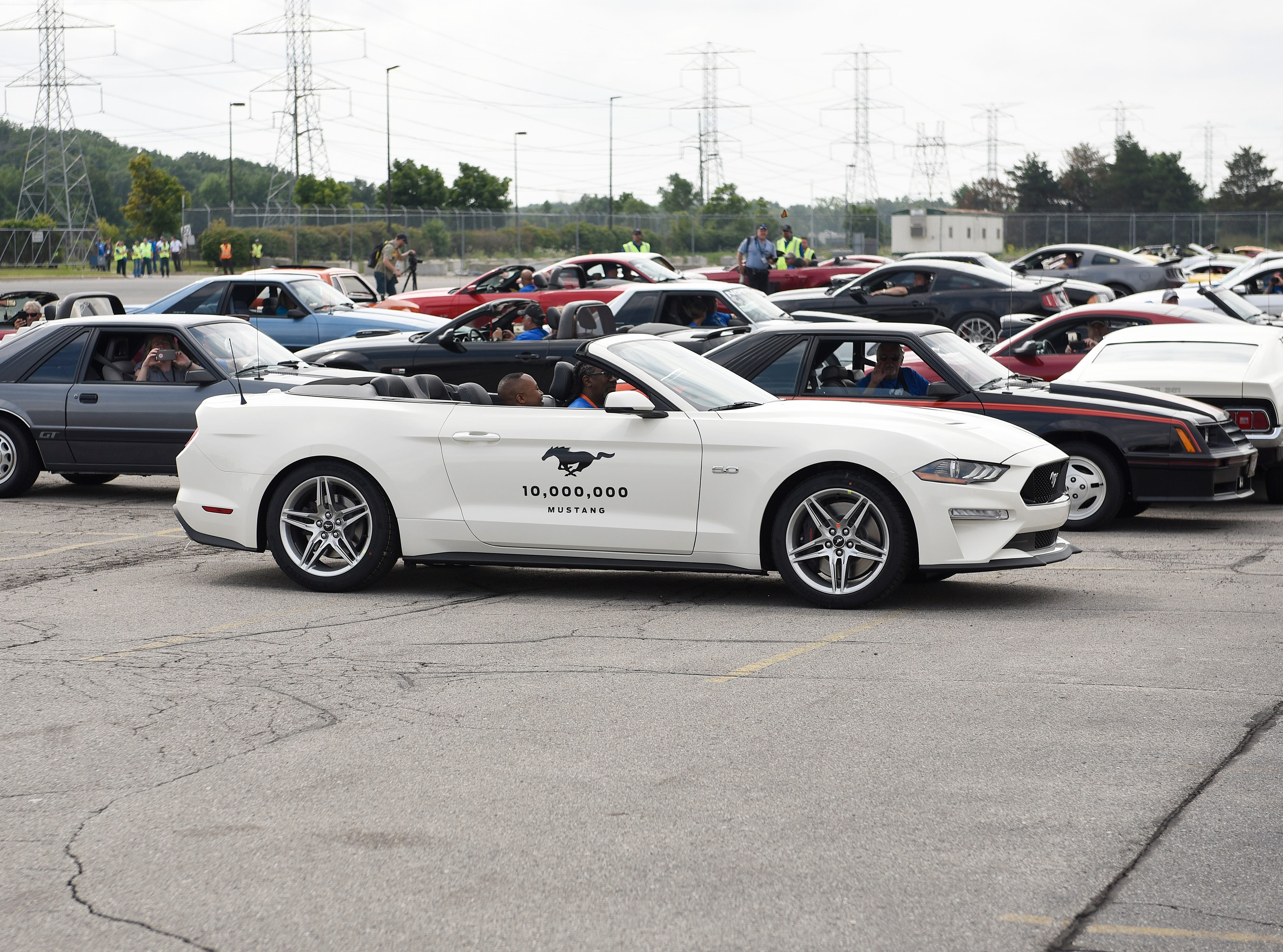 The 10 millionth Mustang enters the gate at the Flat Rock plant to join the other Mustangs to make a formation spelling out 10,000,000.