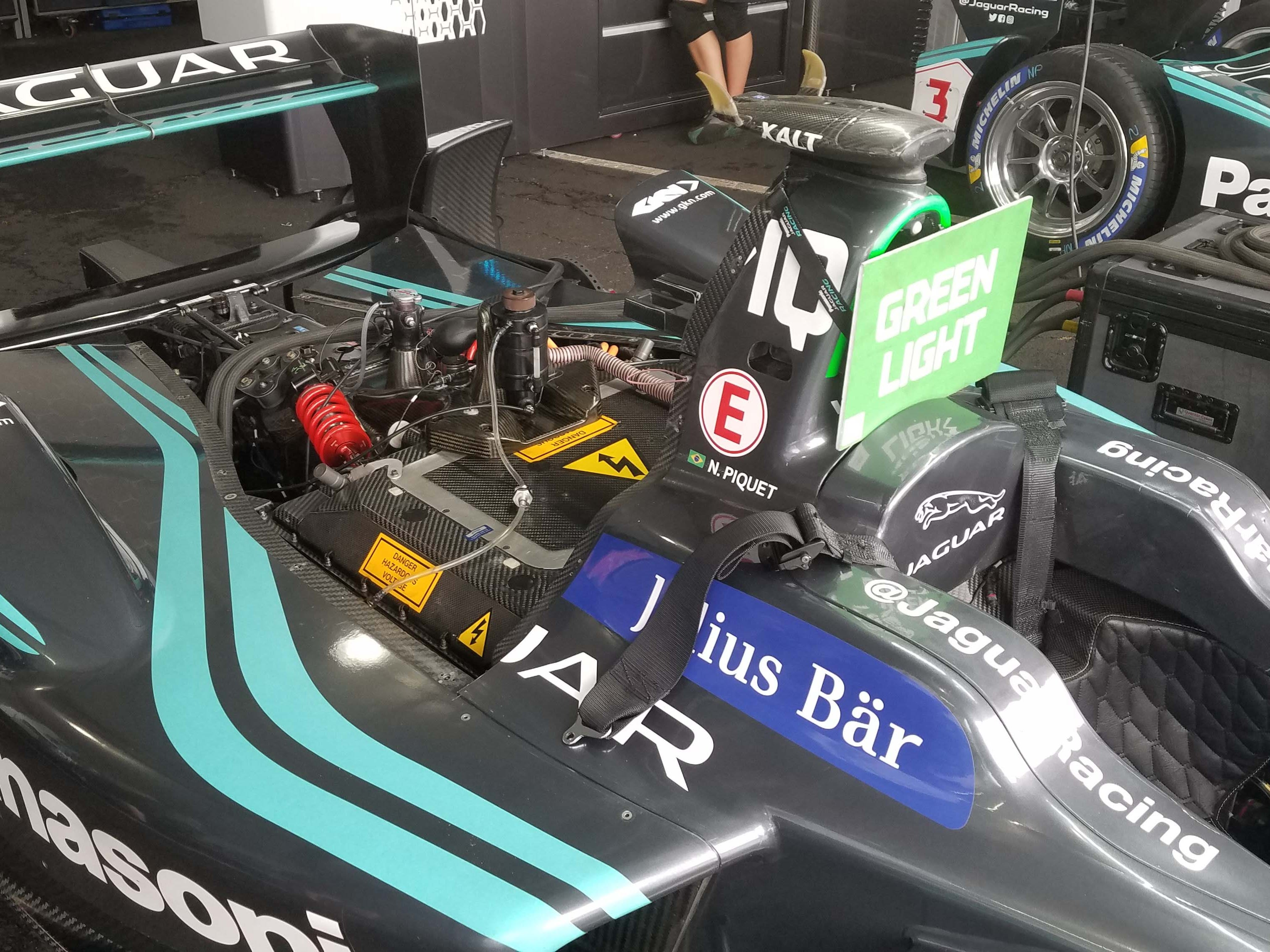 A Formula E car's battery is right behind the driver — where you'll find the engine in a gas-powered car. Carbon-fiber FE chassis closely resemble European Formula One cars.
